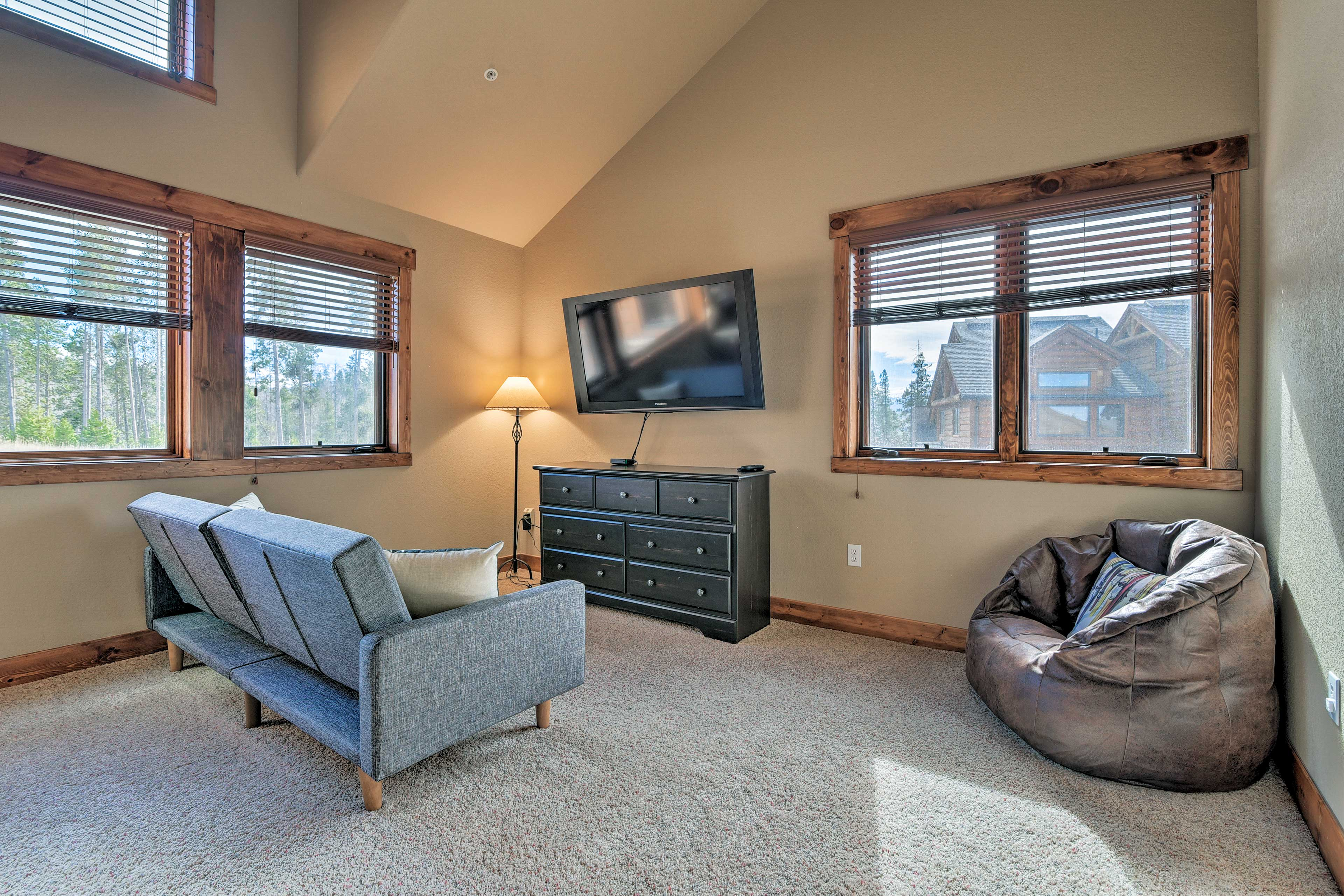 This room is complete with a futon, flat-screen TV, and bean bag chair.