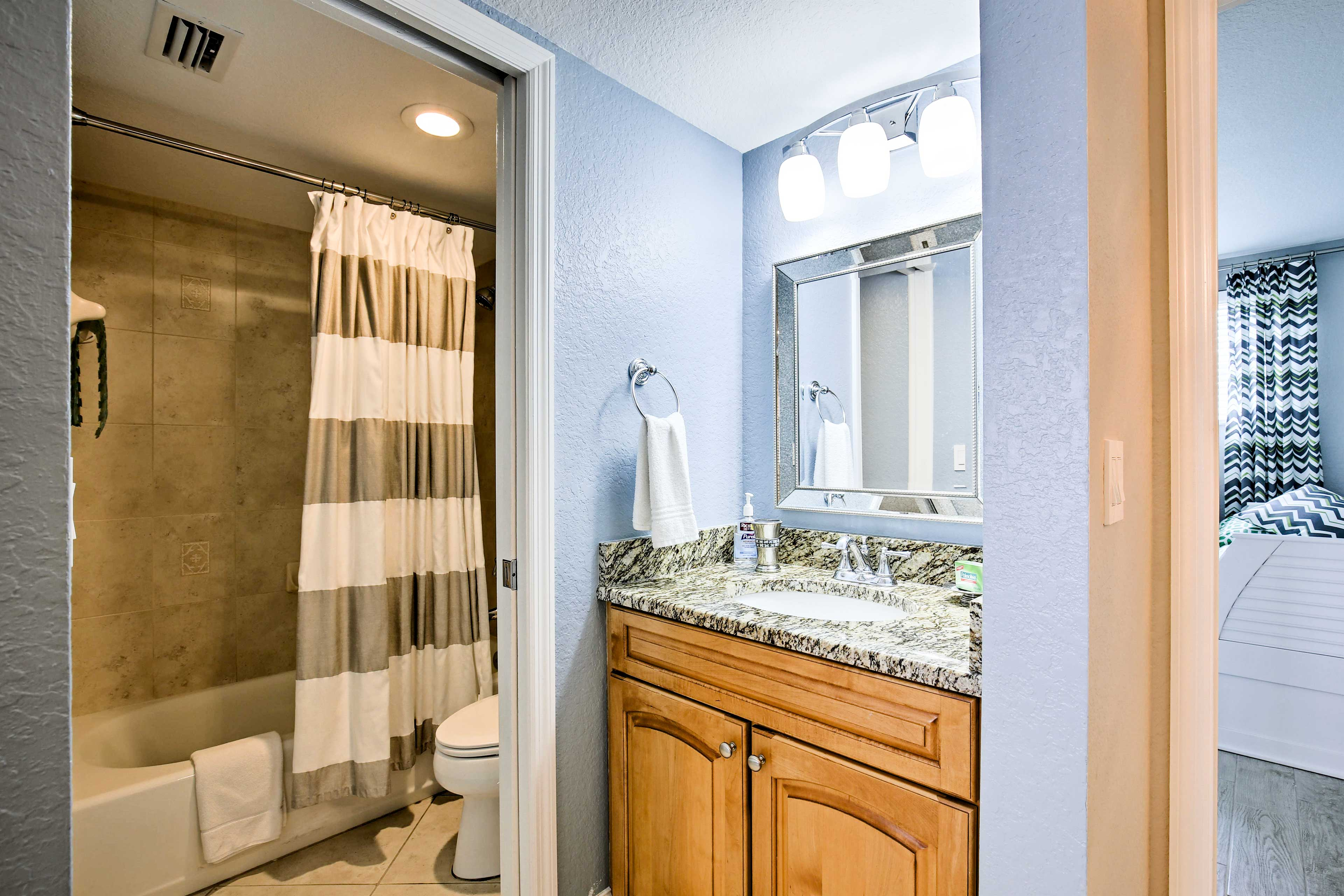 This second full bathroom features a tub/shower combo and separate powder area.