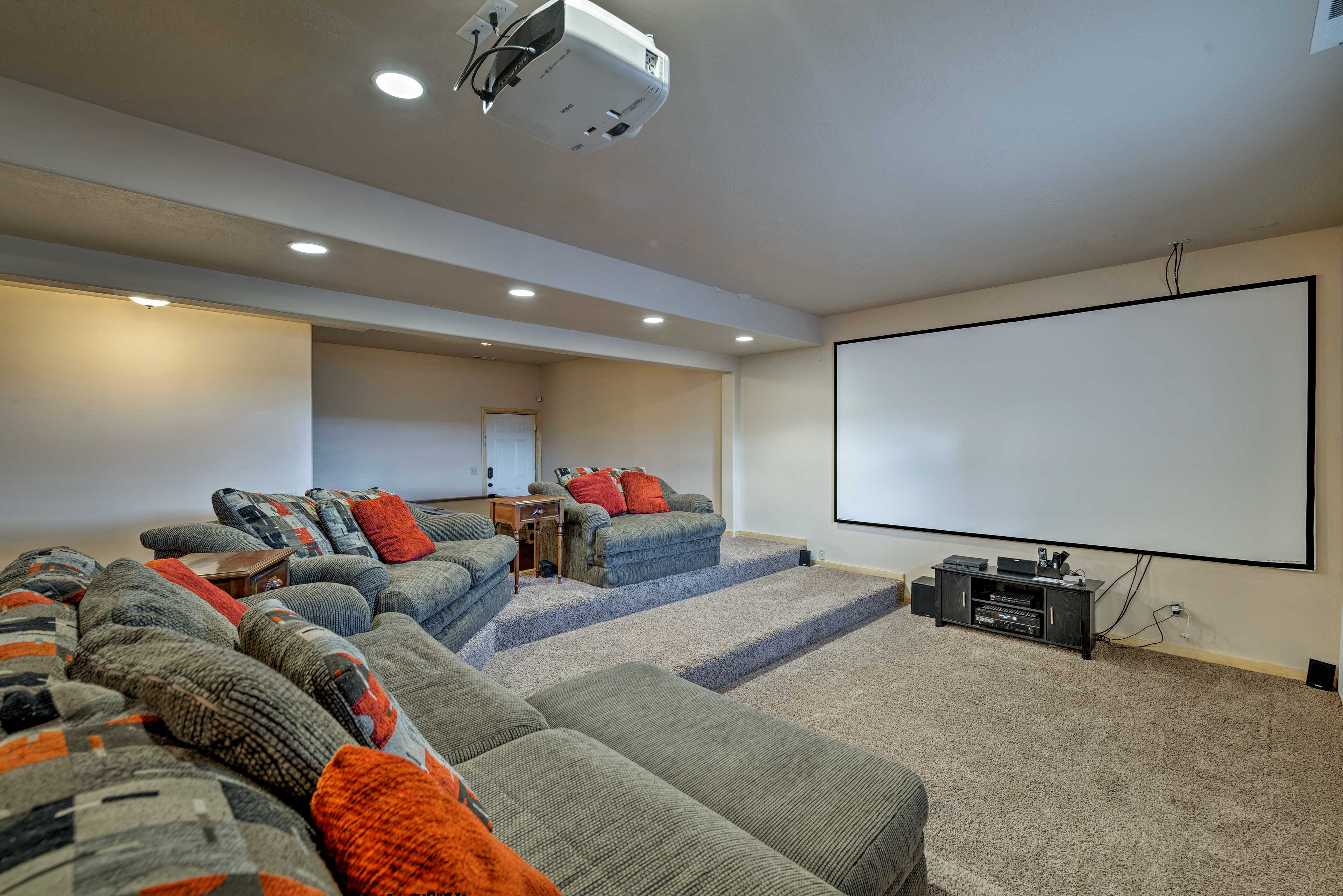 Turn a movie on the big projection screen in the basement.