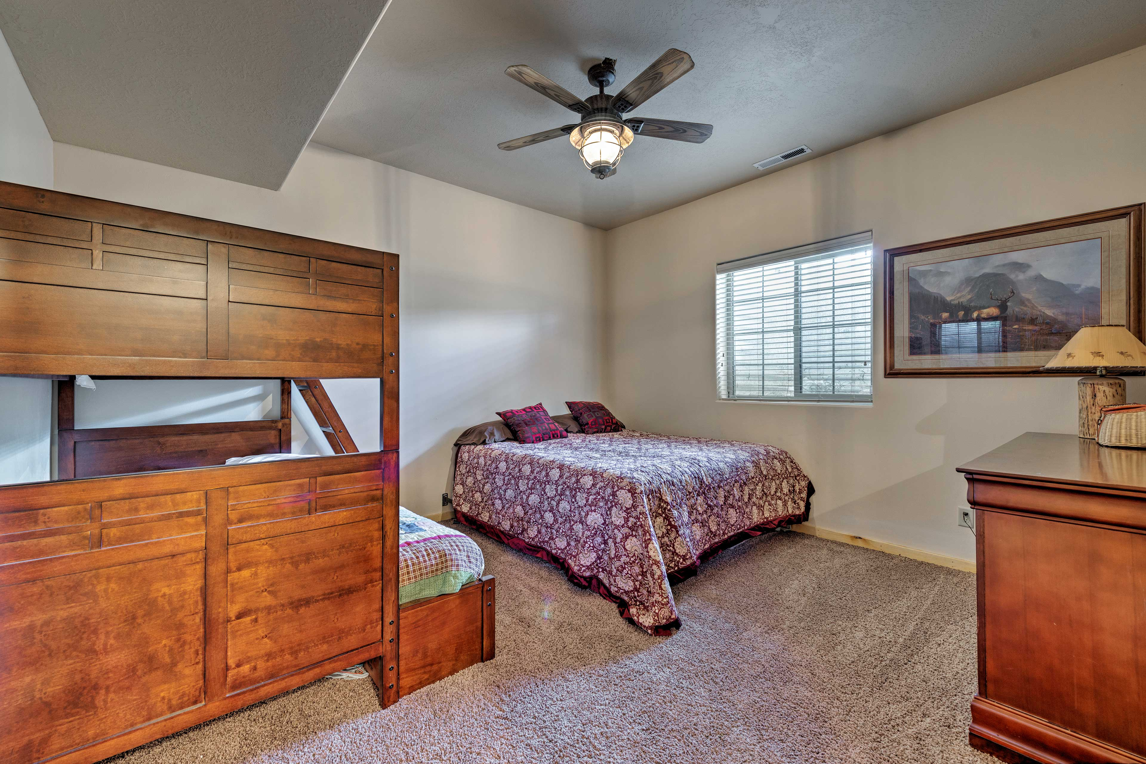 This room now features a king & twin-over-full bunk bed