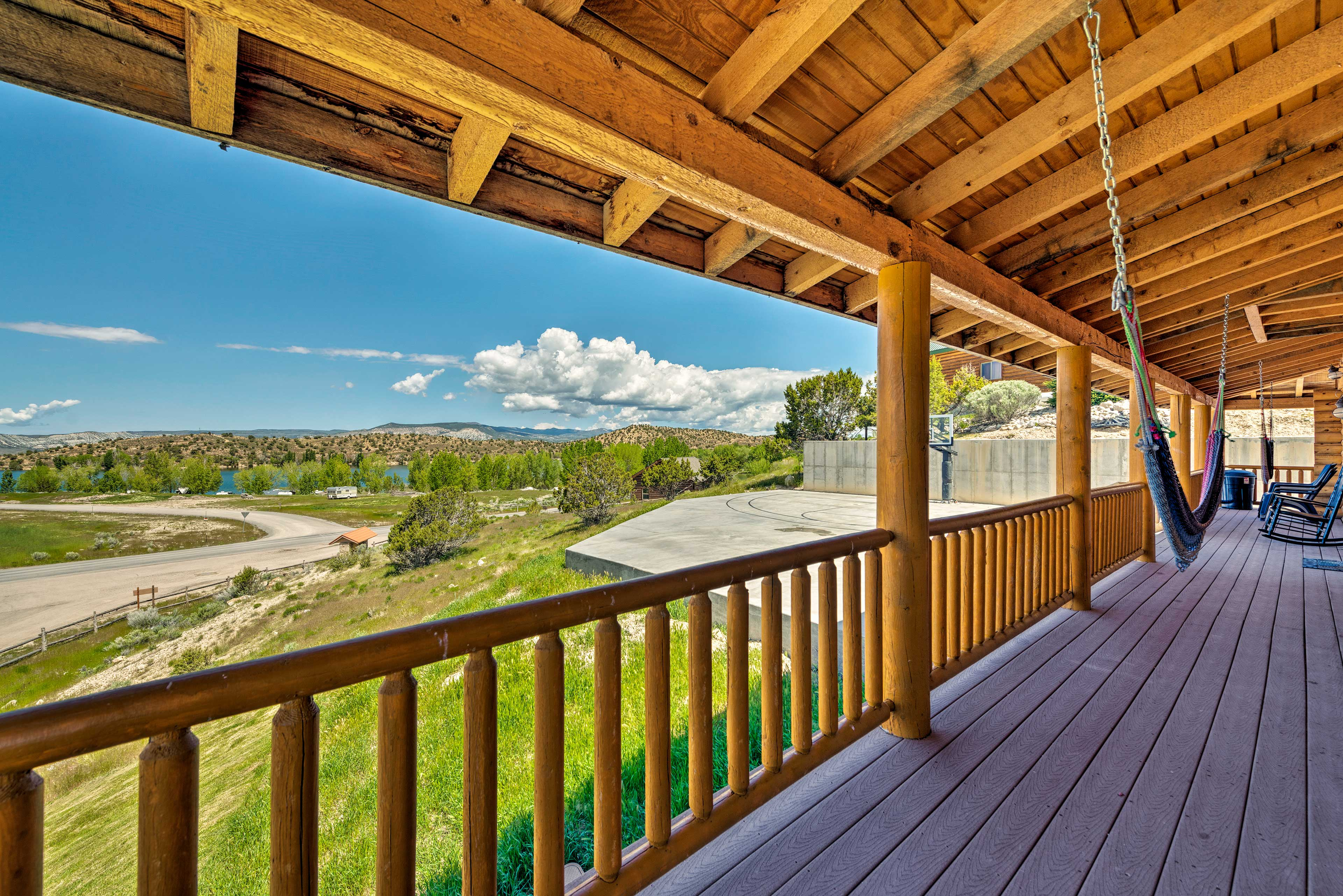 Savor downtime on the front porch, which features spectacular views.
