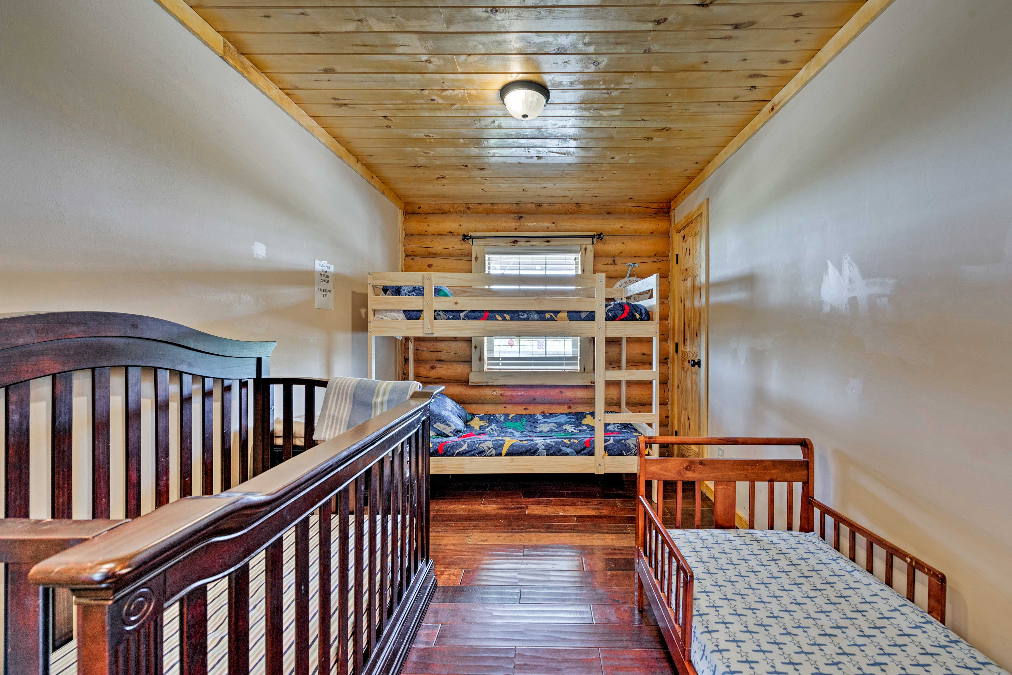 This room is ideal for families, with 2 cribs and a twin bunk bed.
