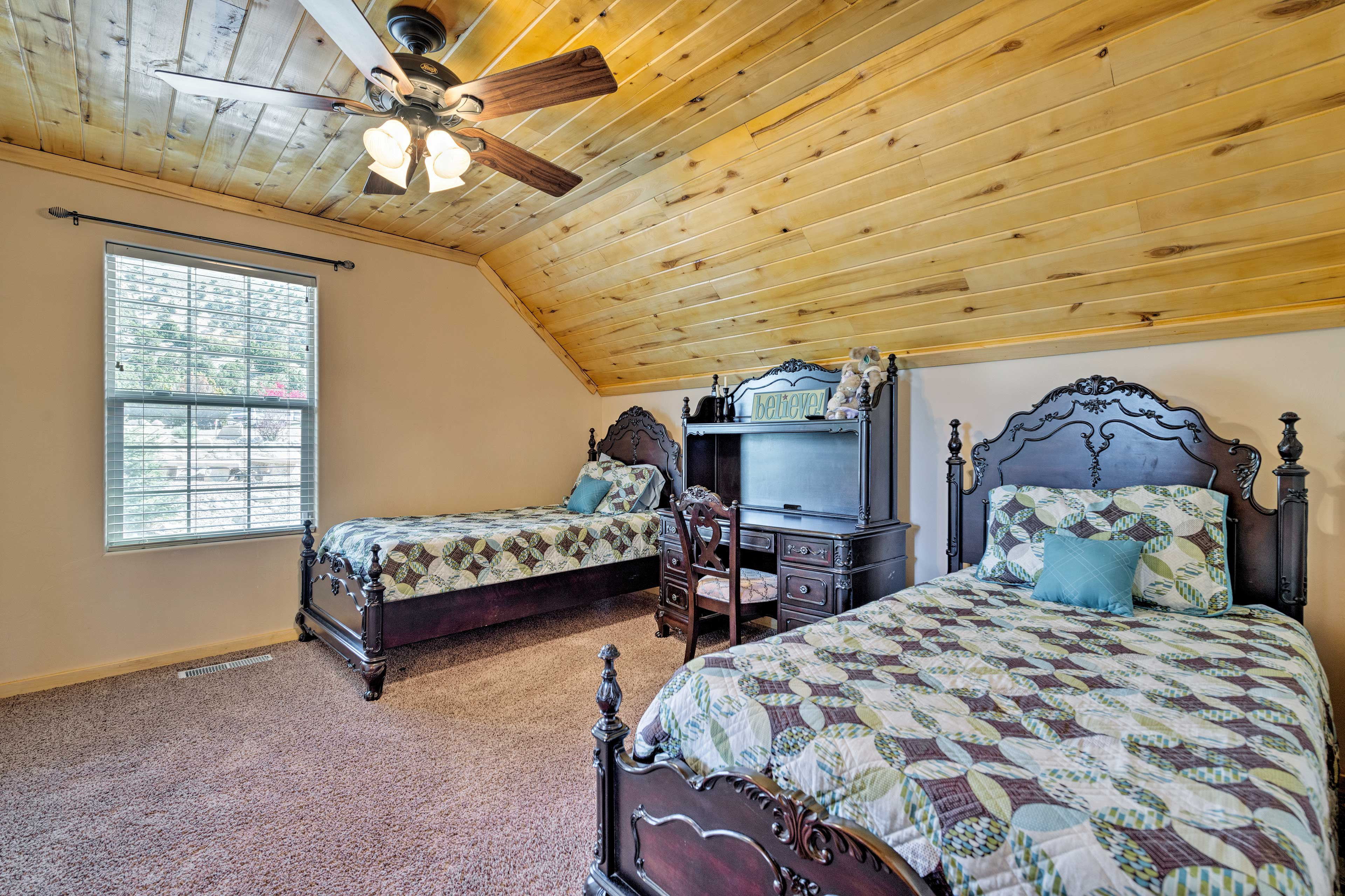 Two twin beds are located in the third bedroom.