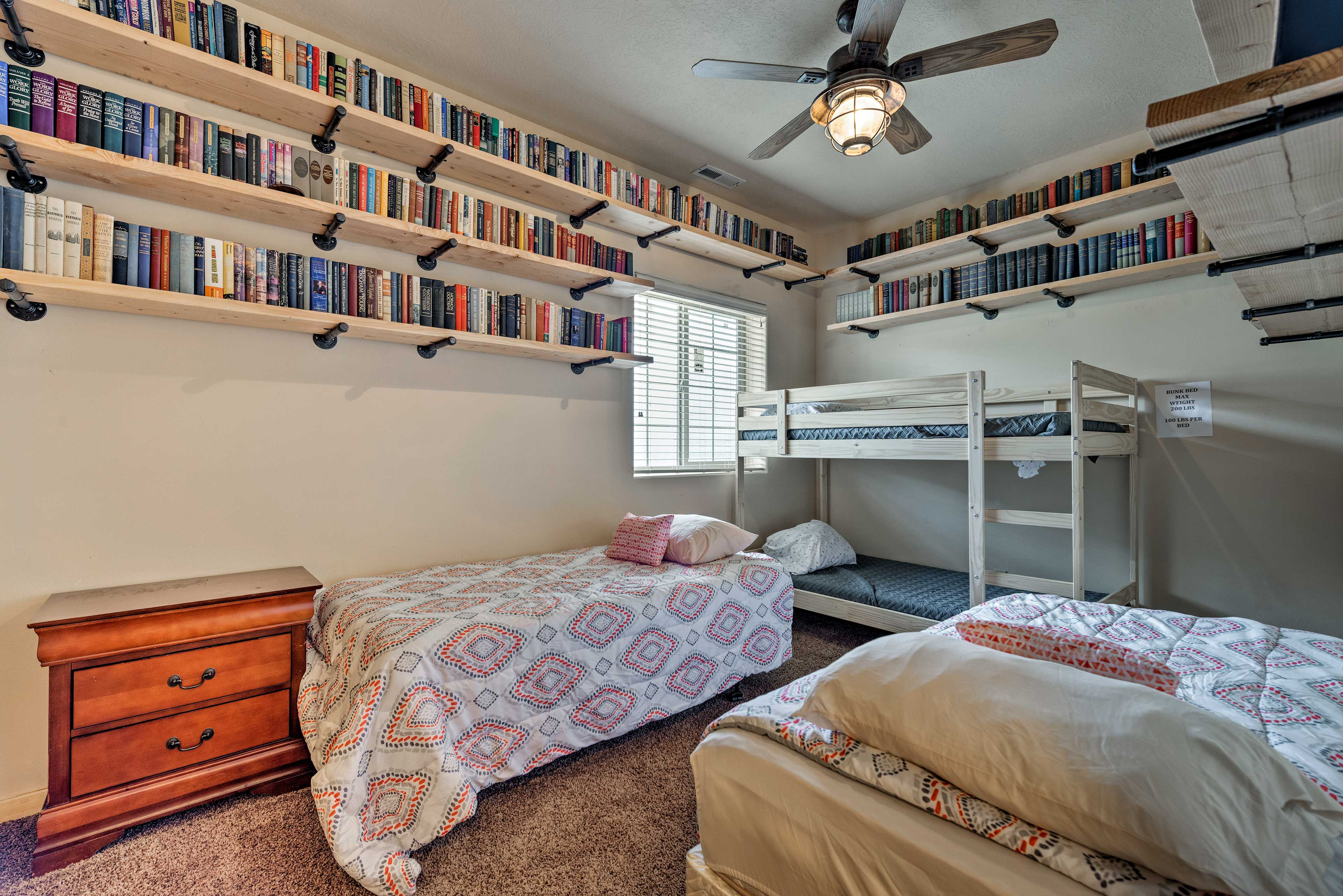 This room now features 2 twin beds and a twin bunk bed!