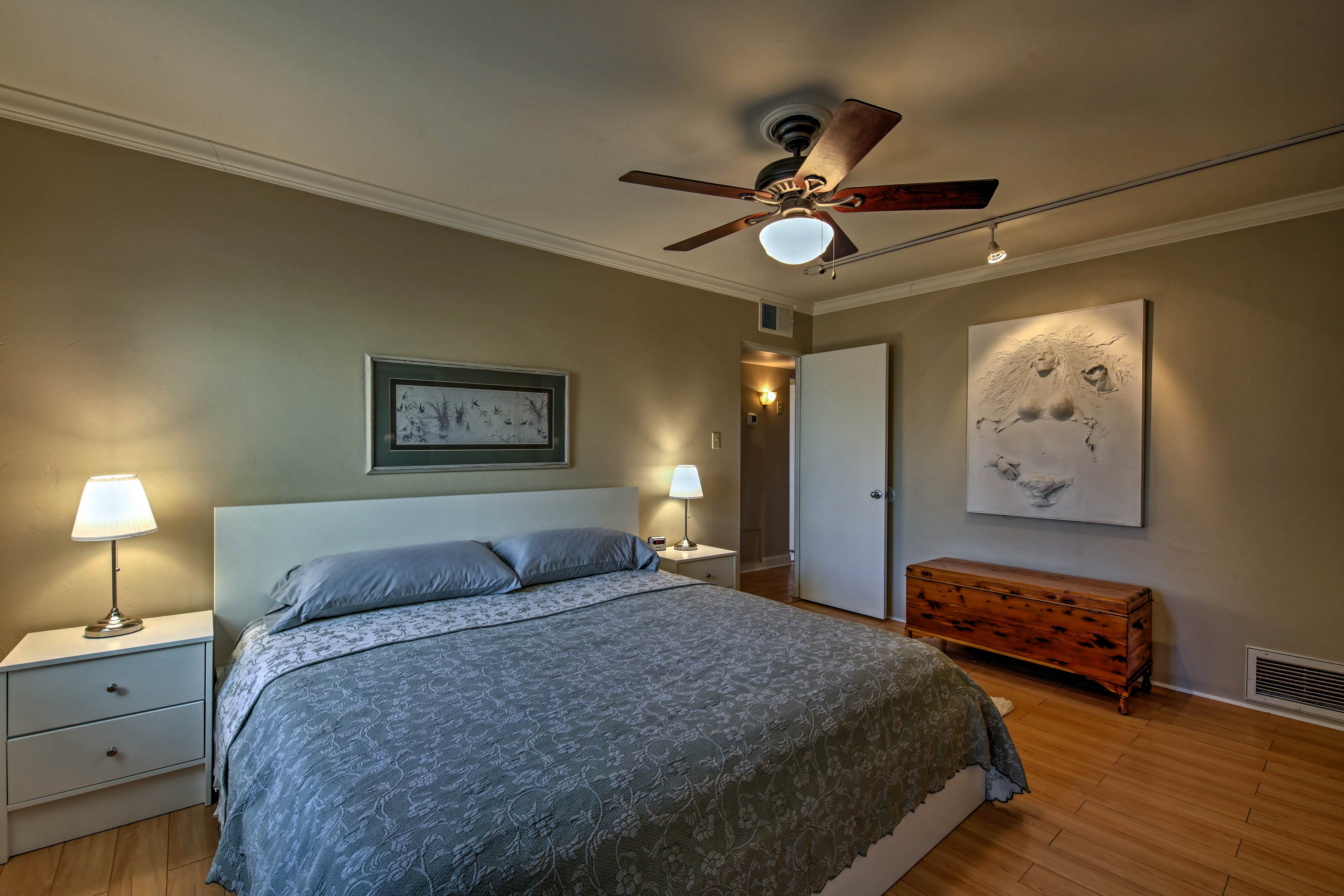 Retire to the master bedroom to rest on the king-sized bed.