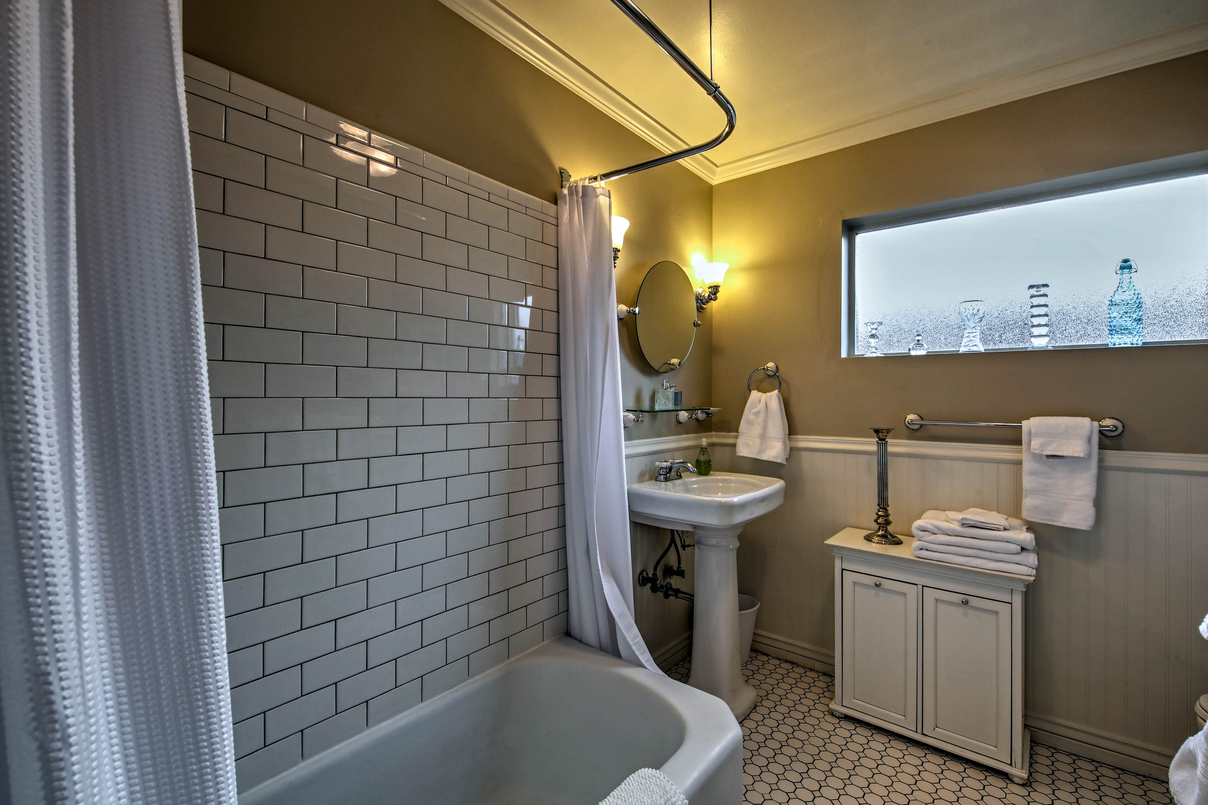 Subway tile highlights the shower/tub combo in the second bathroom.