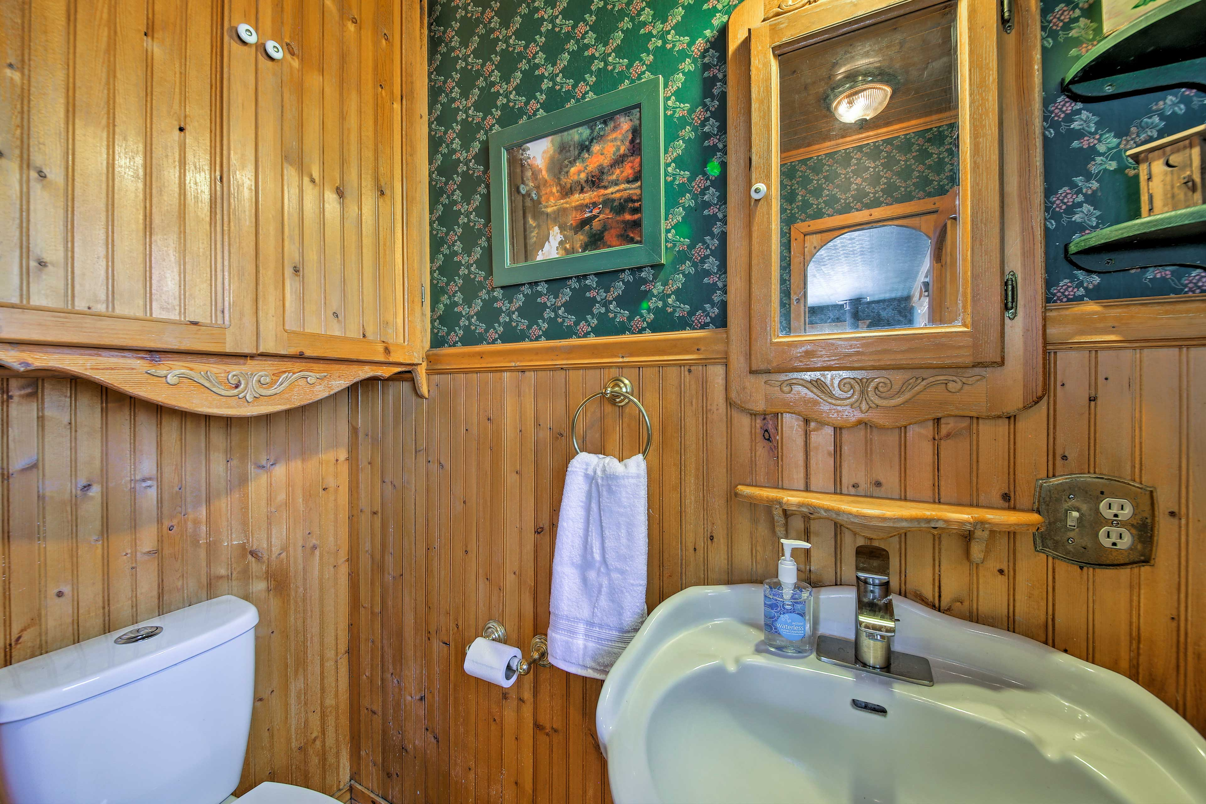 This bathroom is located just off of the living room.
