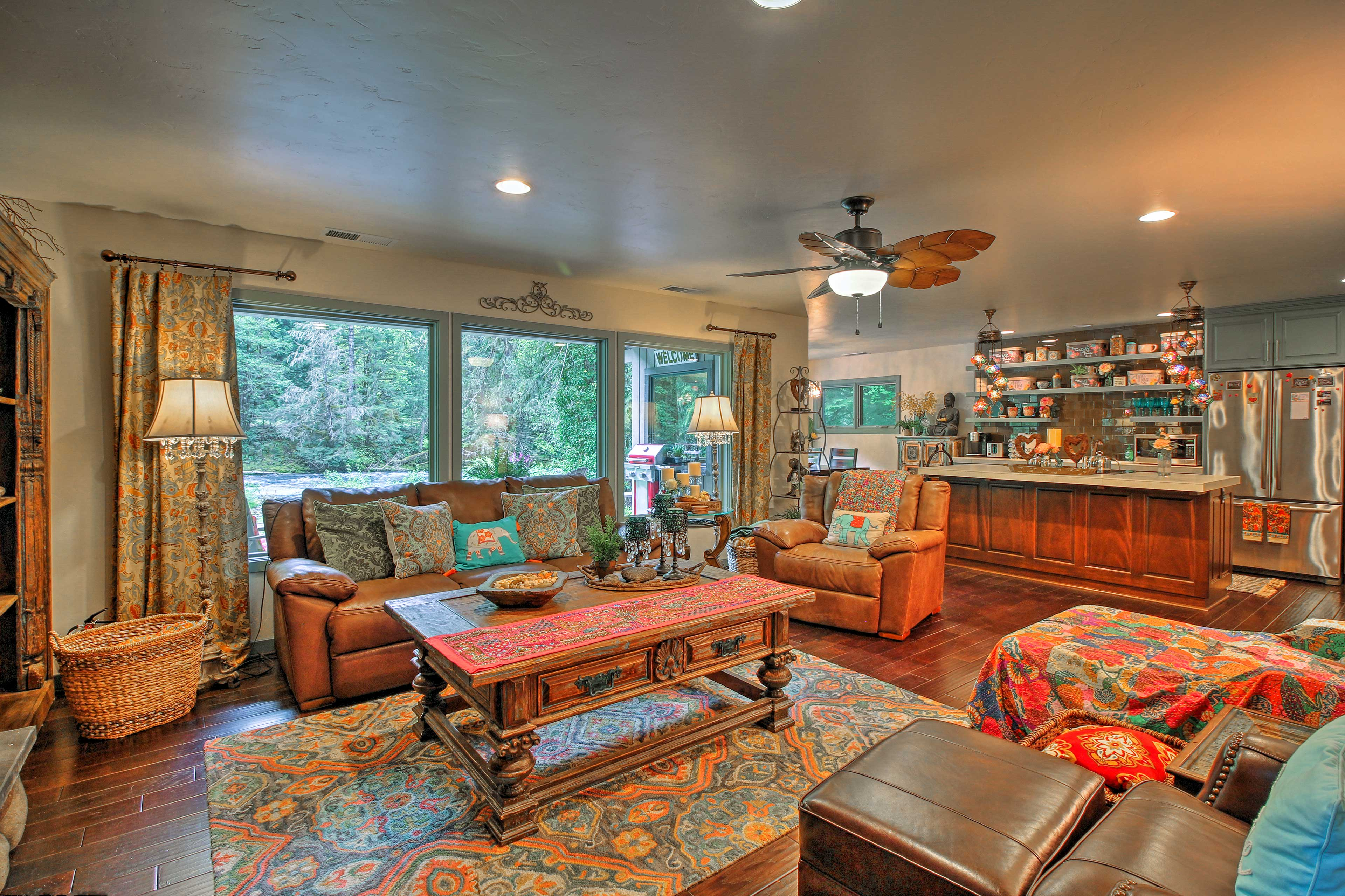 Plush furnishings and a wood burning fireplace go well with the view.