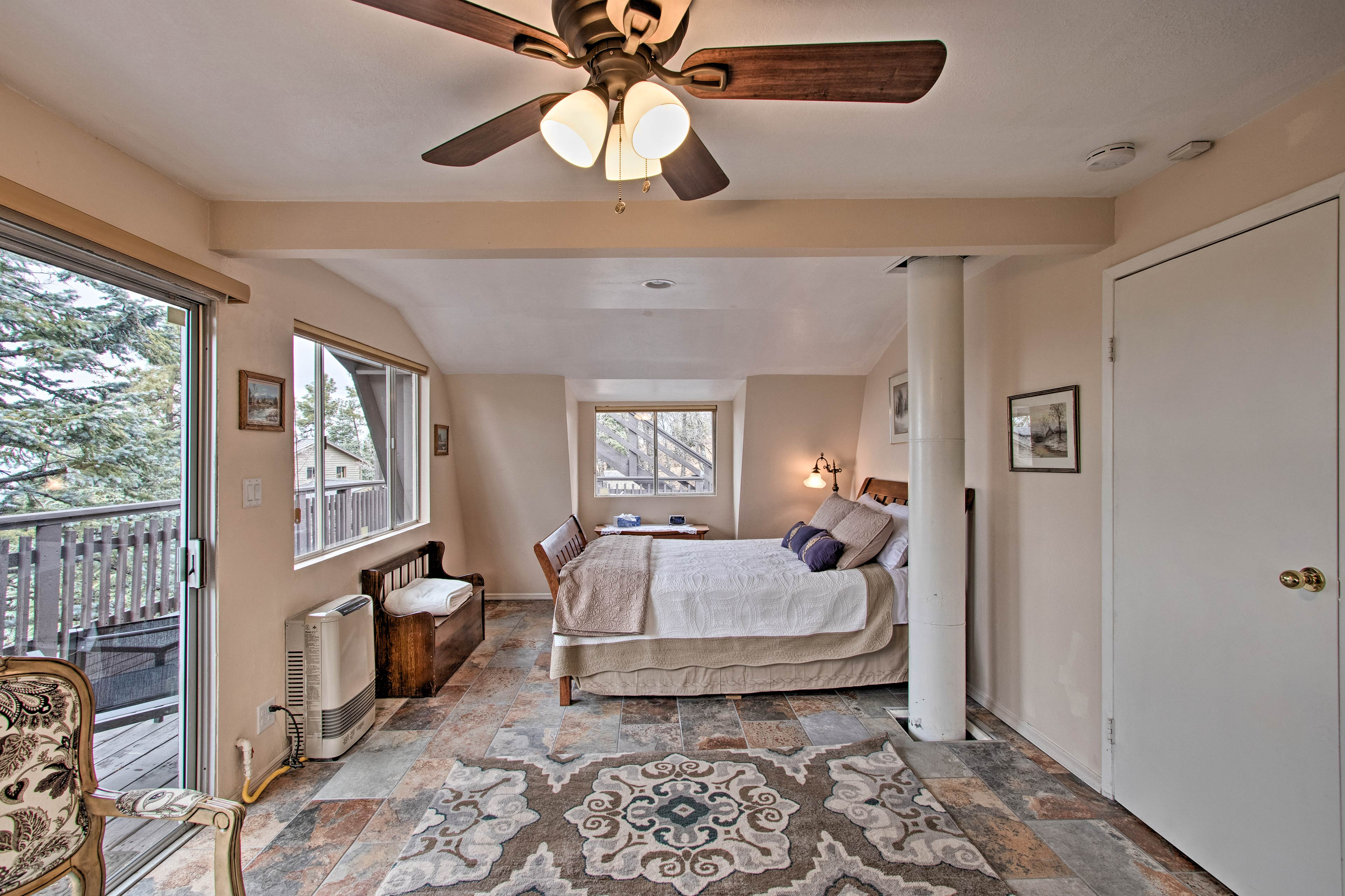 The master bedroom offers a queen bed and private deck access.