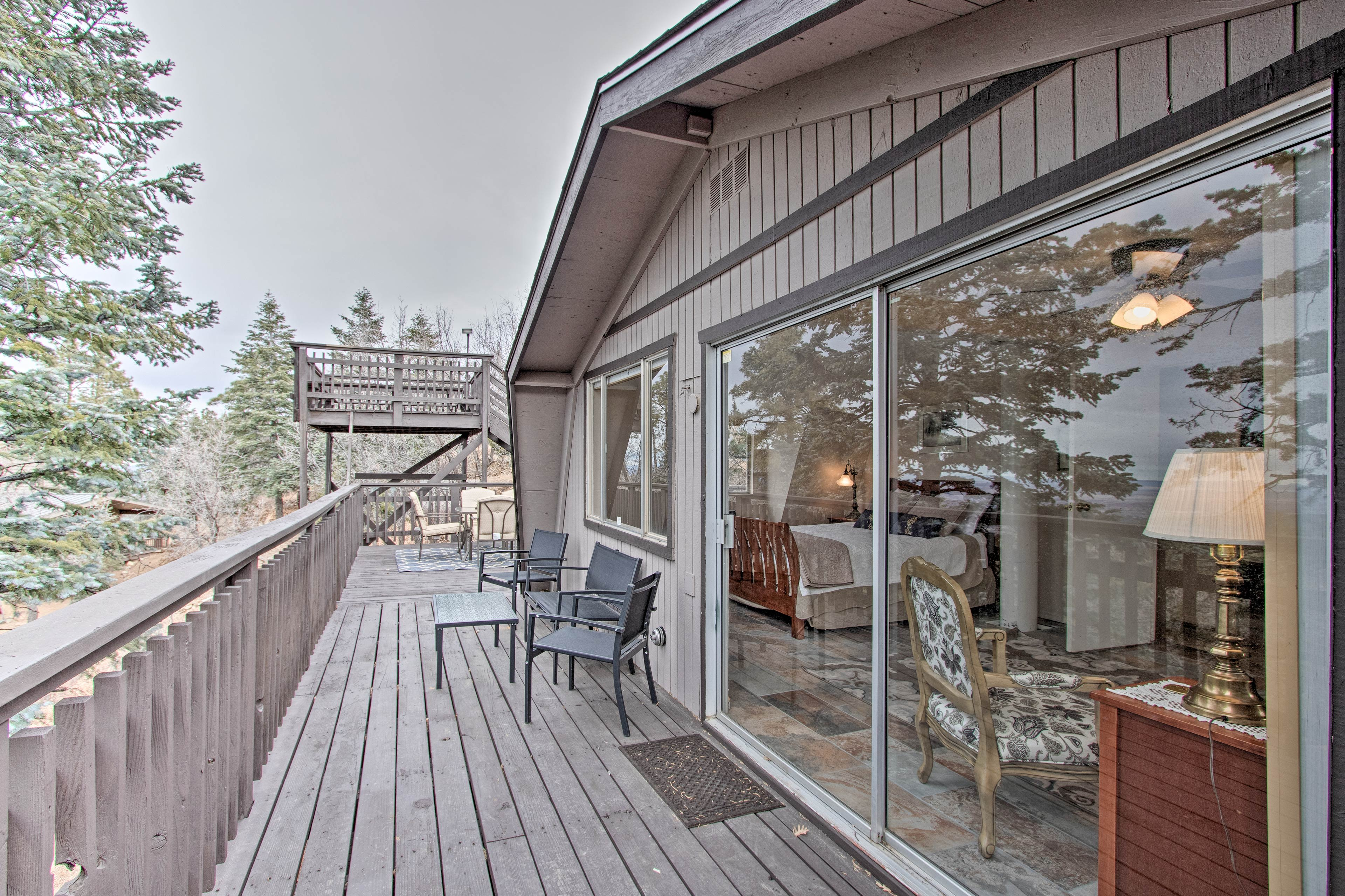 Step through the sliding glass doors out to your private deck.