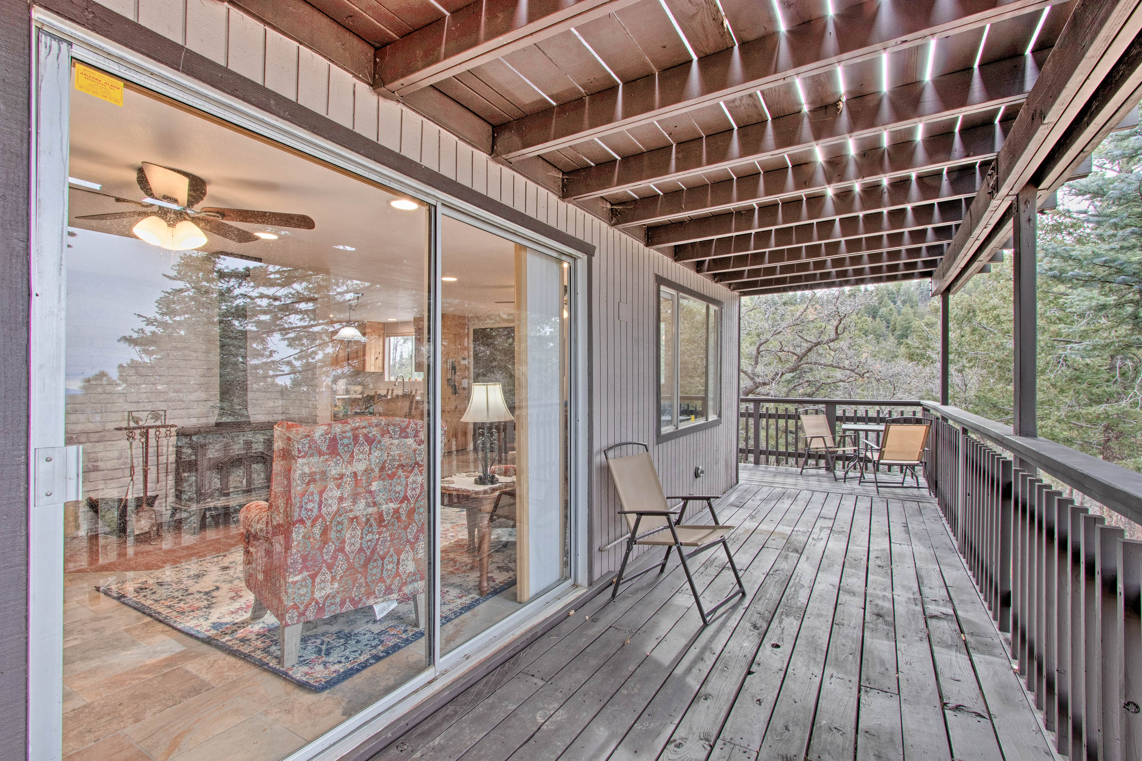 Breathe in that fresh pine-scented air on the covered deck.