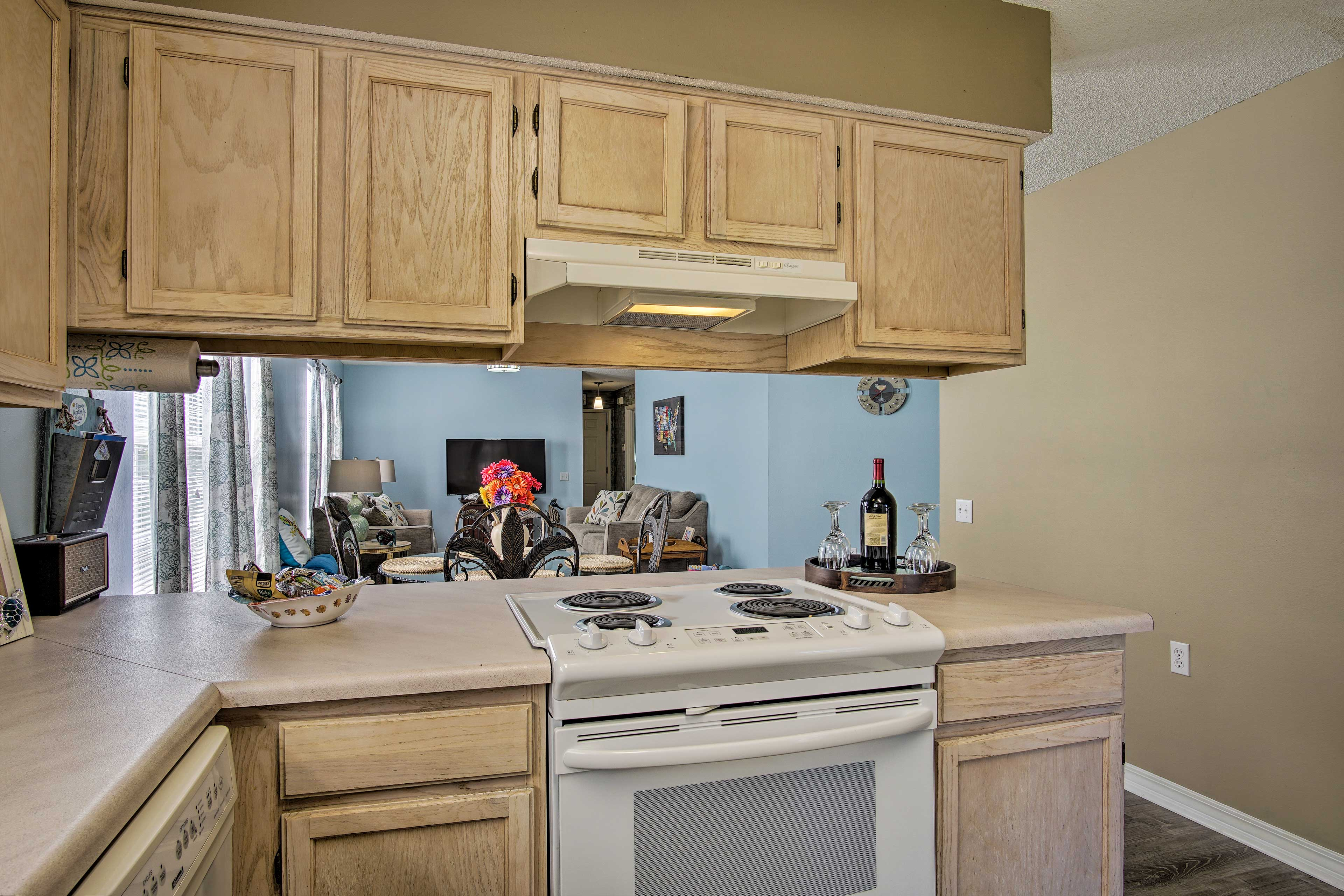 The fully equipped kitchen is stocked with all the cooking essentials.