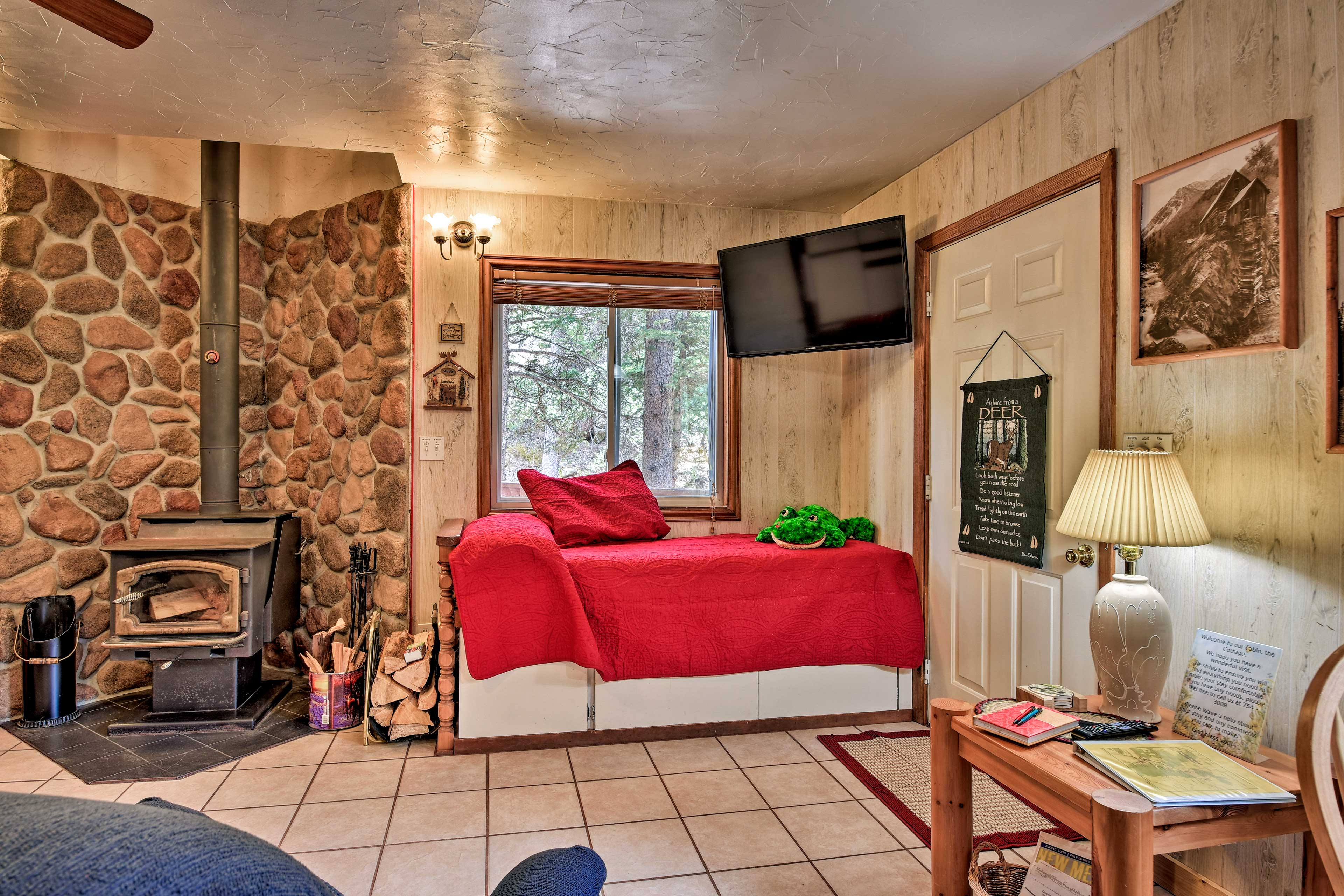 Two twin beds and a flat-screen Direct TV are located in the living room.