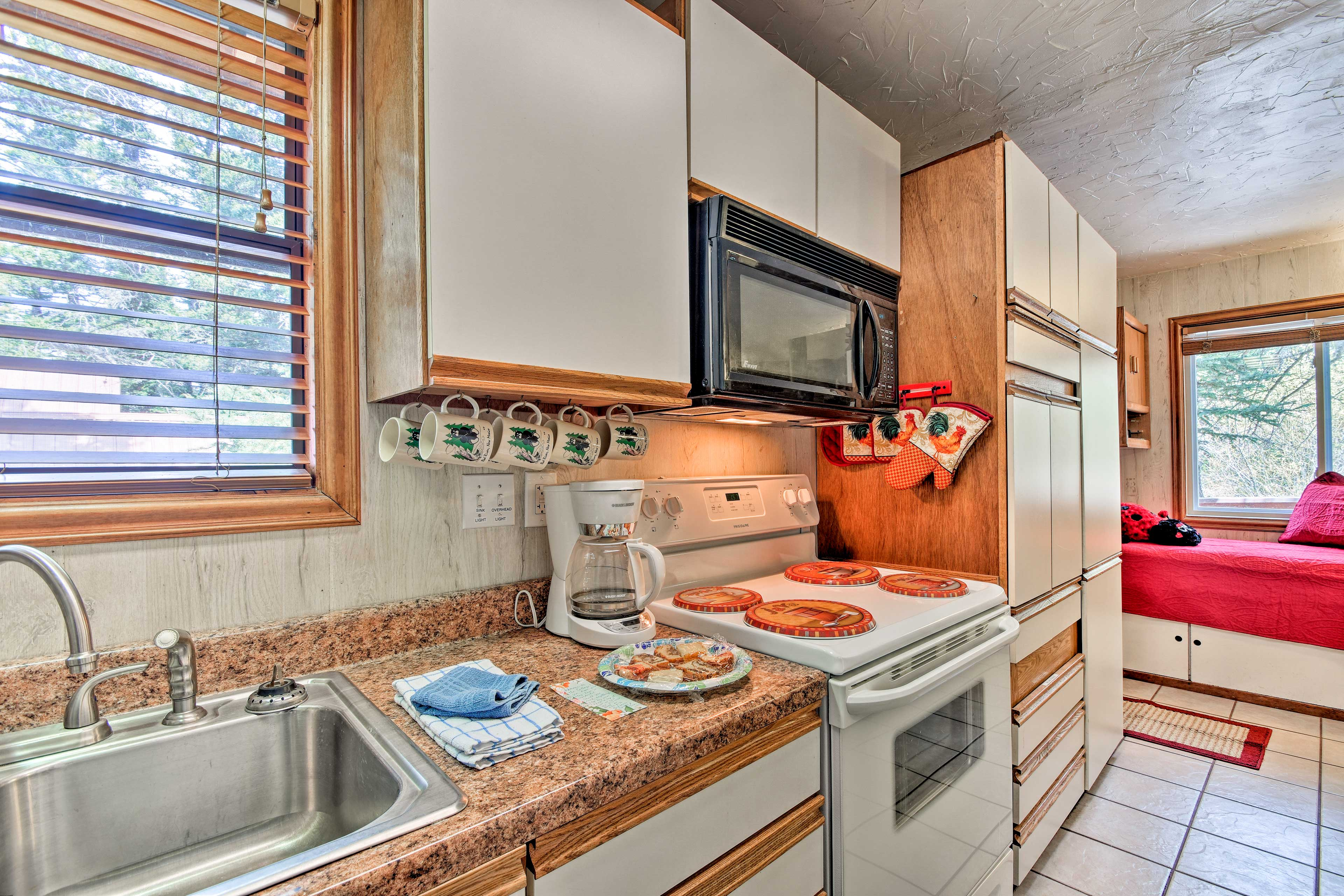 The kitchen is well-equipped with appliances.