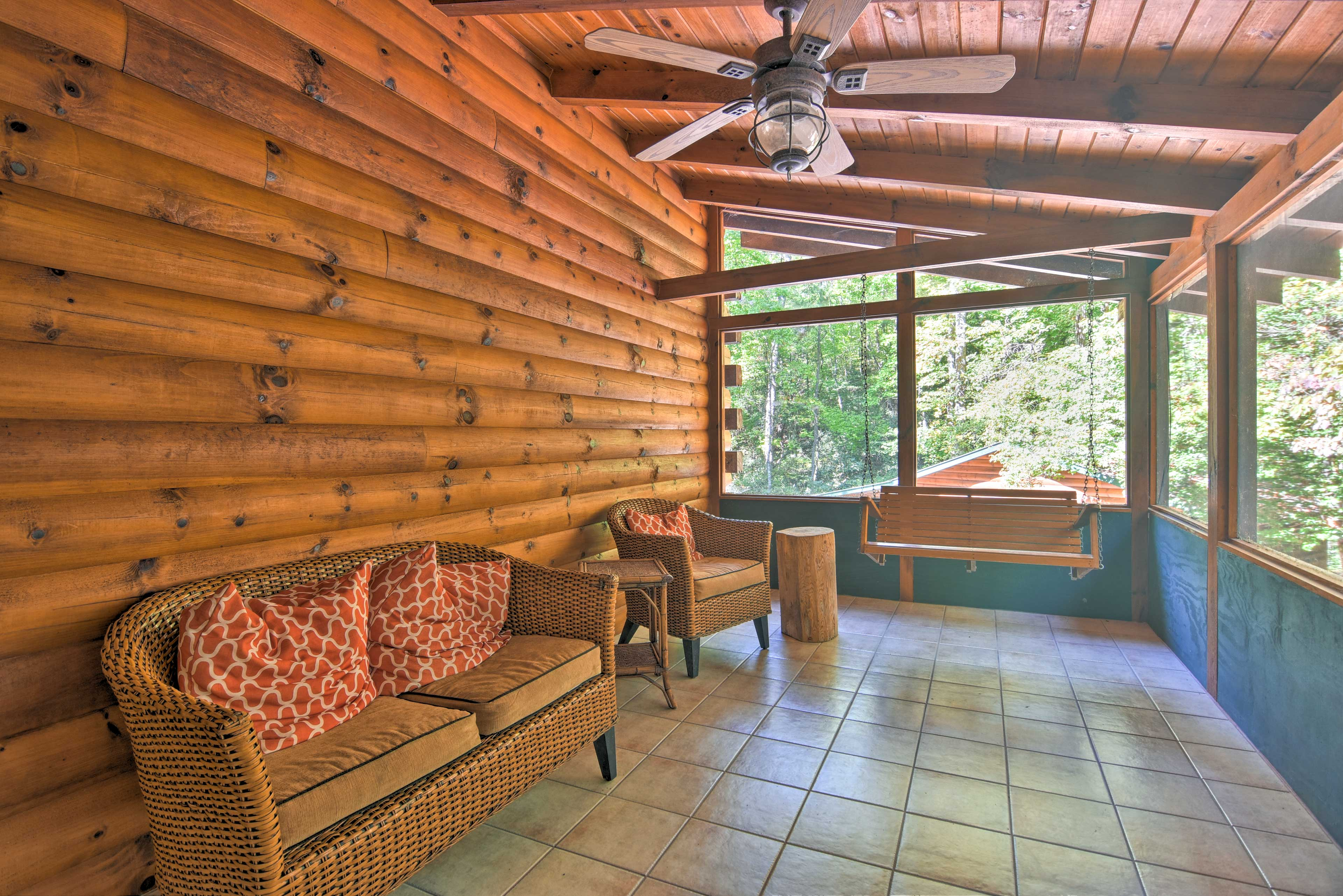 Spend countless hours enjoying the views from the screened porch.
