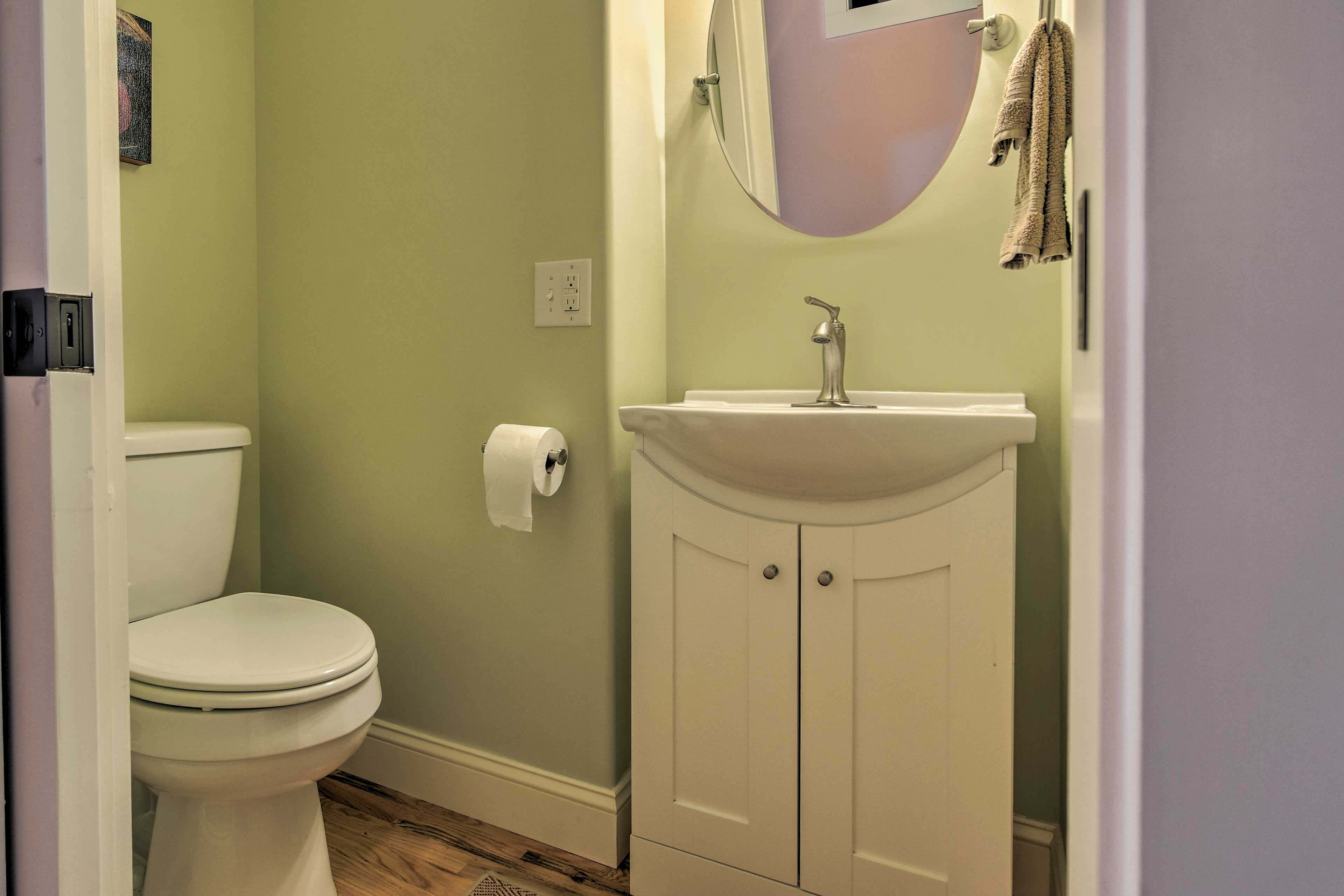 An additional half bathroom is offered on the main floor.