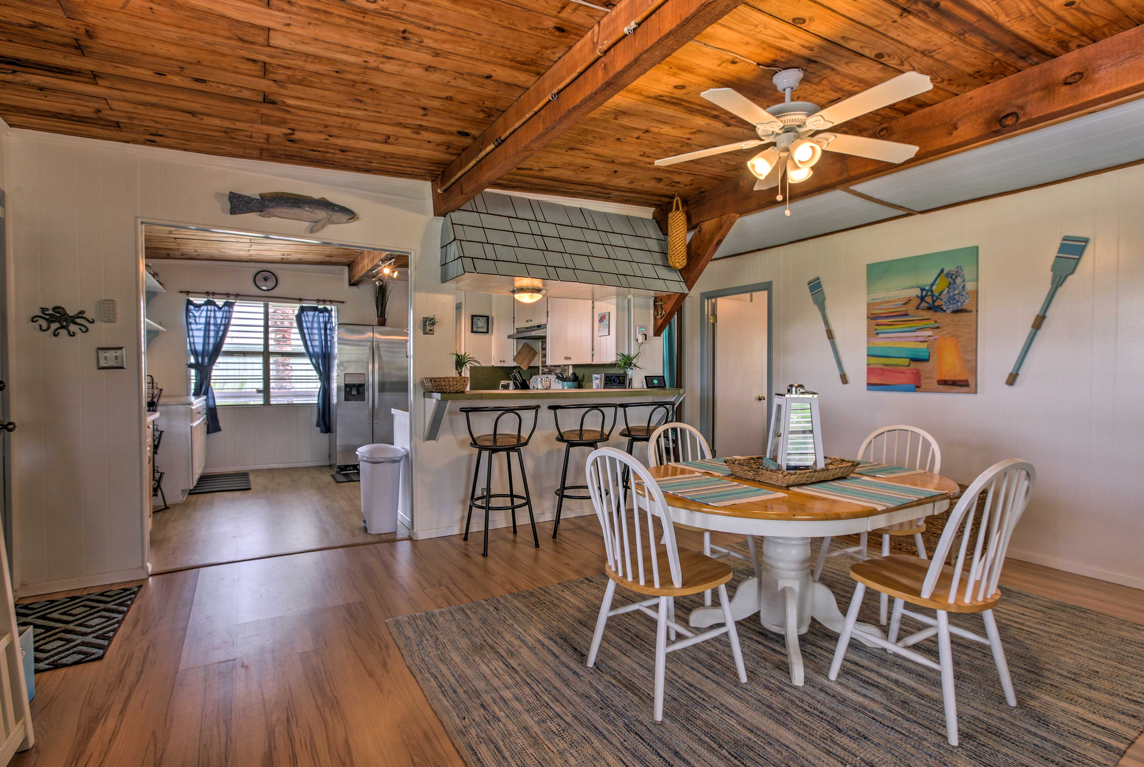 This home is highlighted by rustic furnishings and island decor.