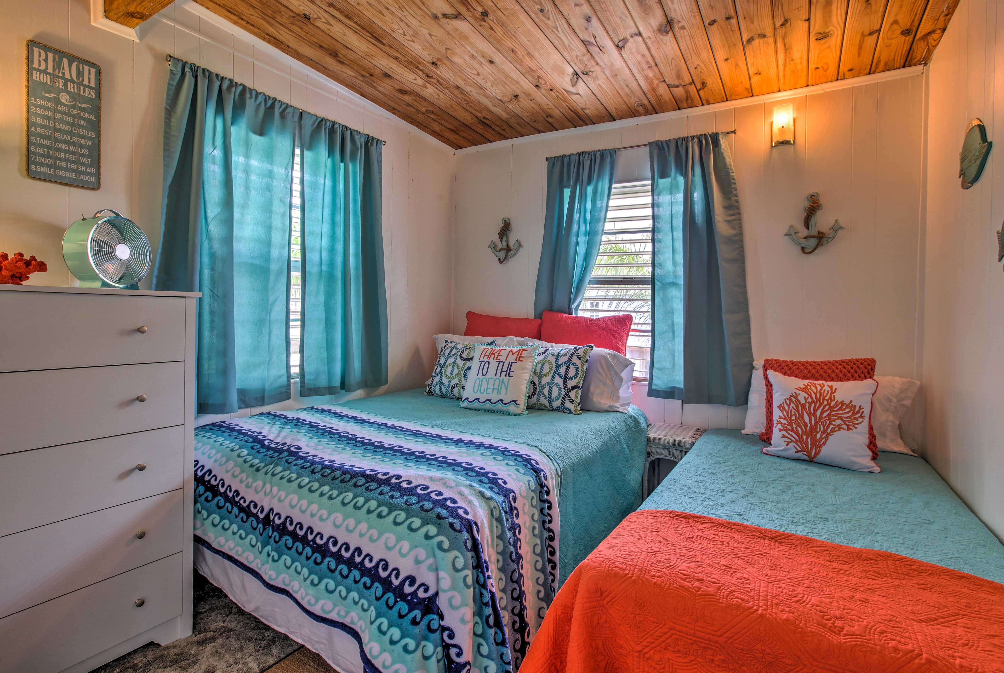 Colorful and cozy, this bedroom offers a queen and twin bed.