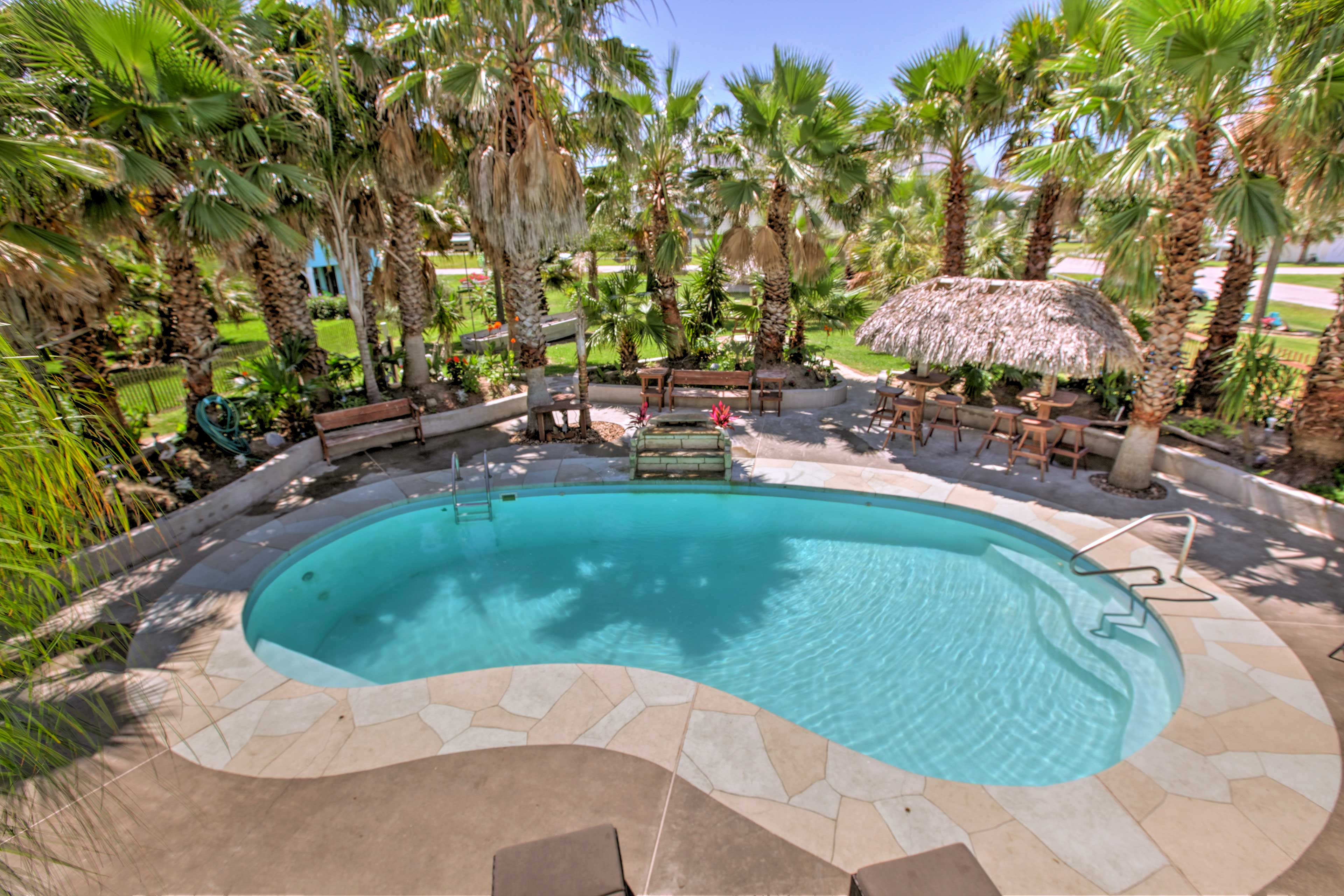 This stunning home is nestled in a lush, tropical garden less than a mile from the coast.