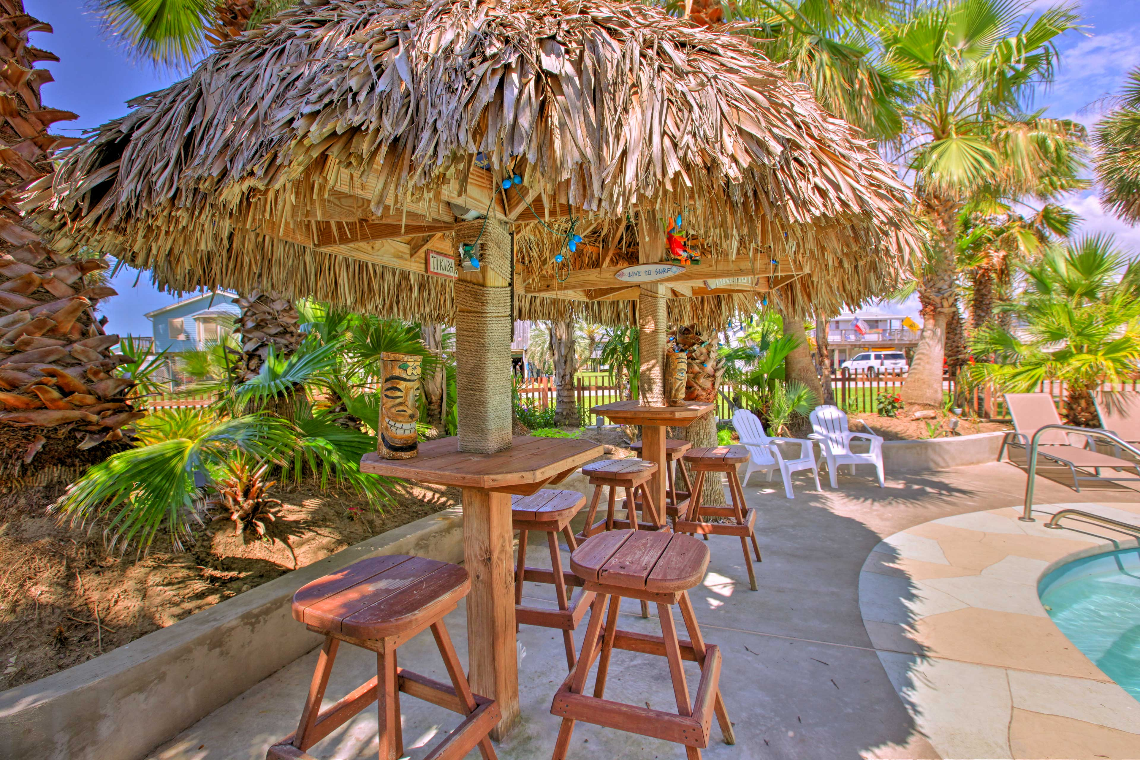 Enjoy island living under the palapa huts.