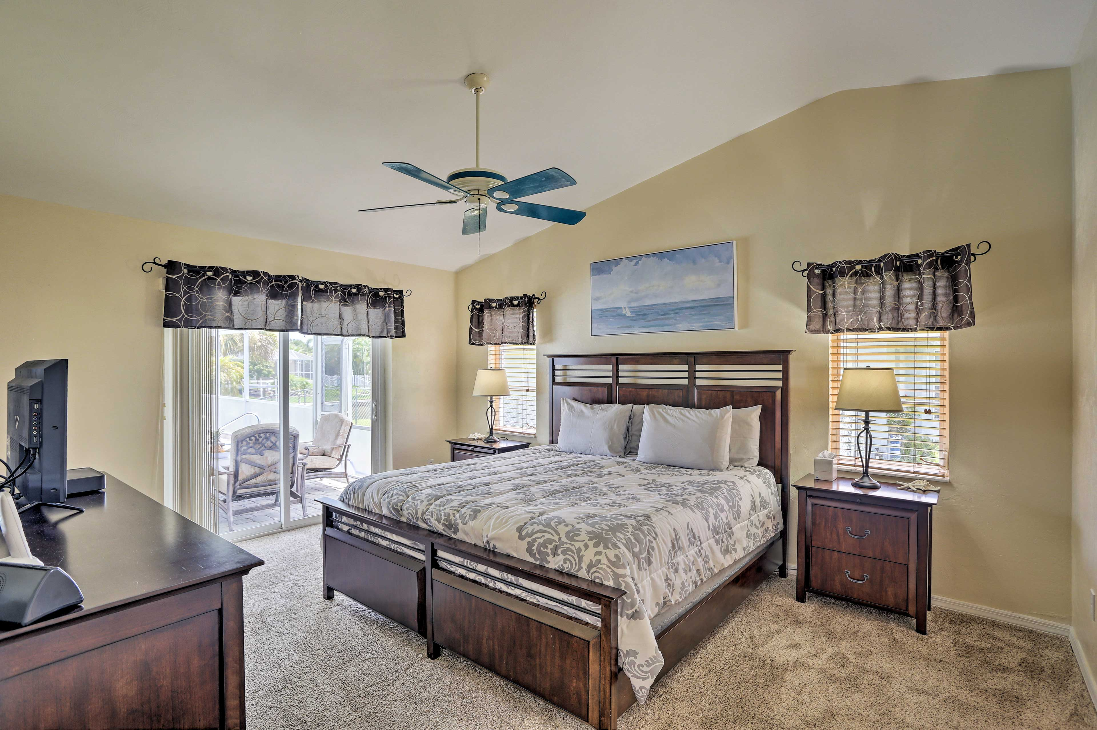 The master bedroom offers direct access to the lanai, spa, and pool.