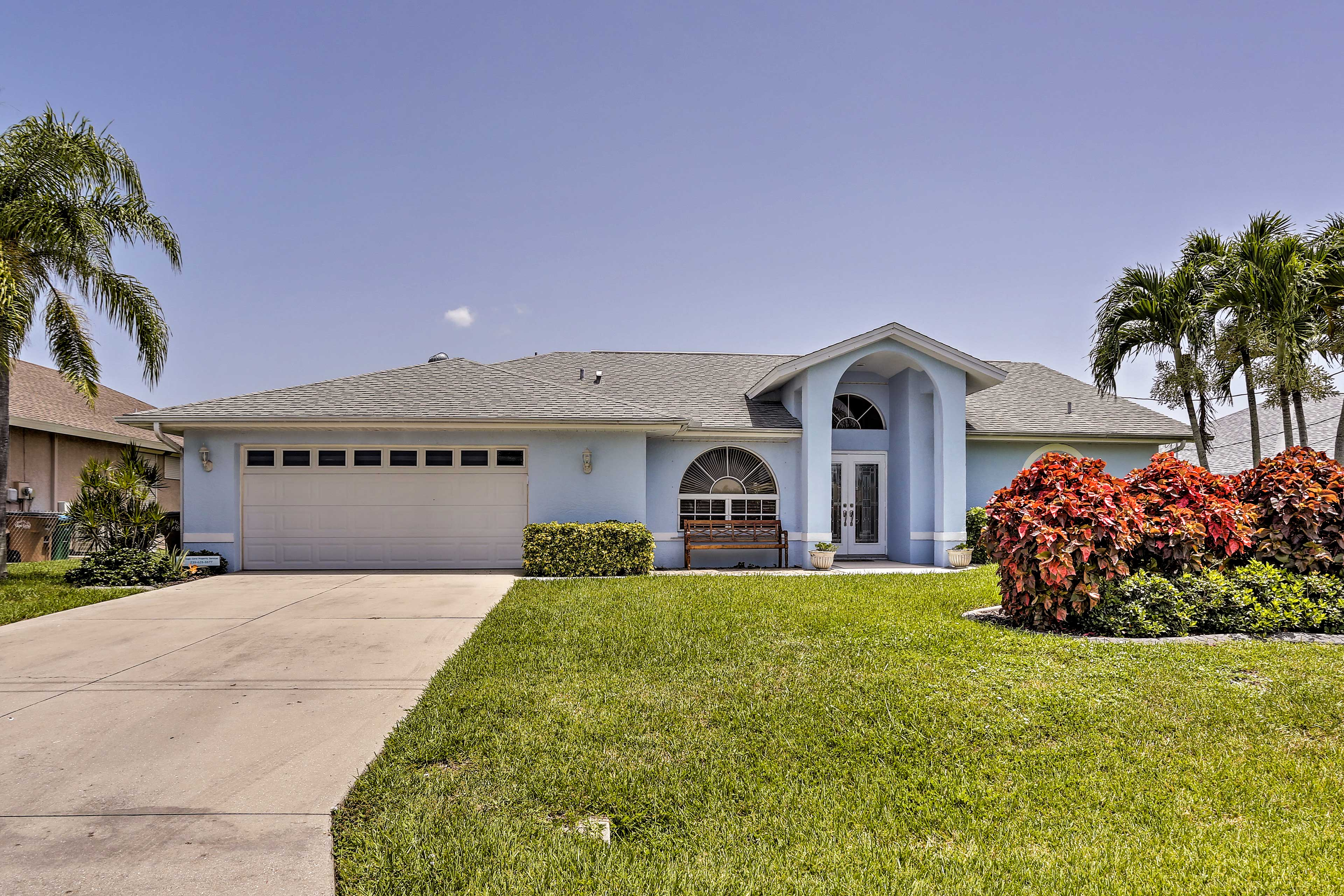 Park 2 cars in the garage and 4 more in the driveway of this Cape Coral home.