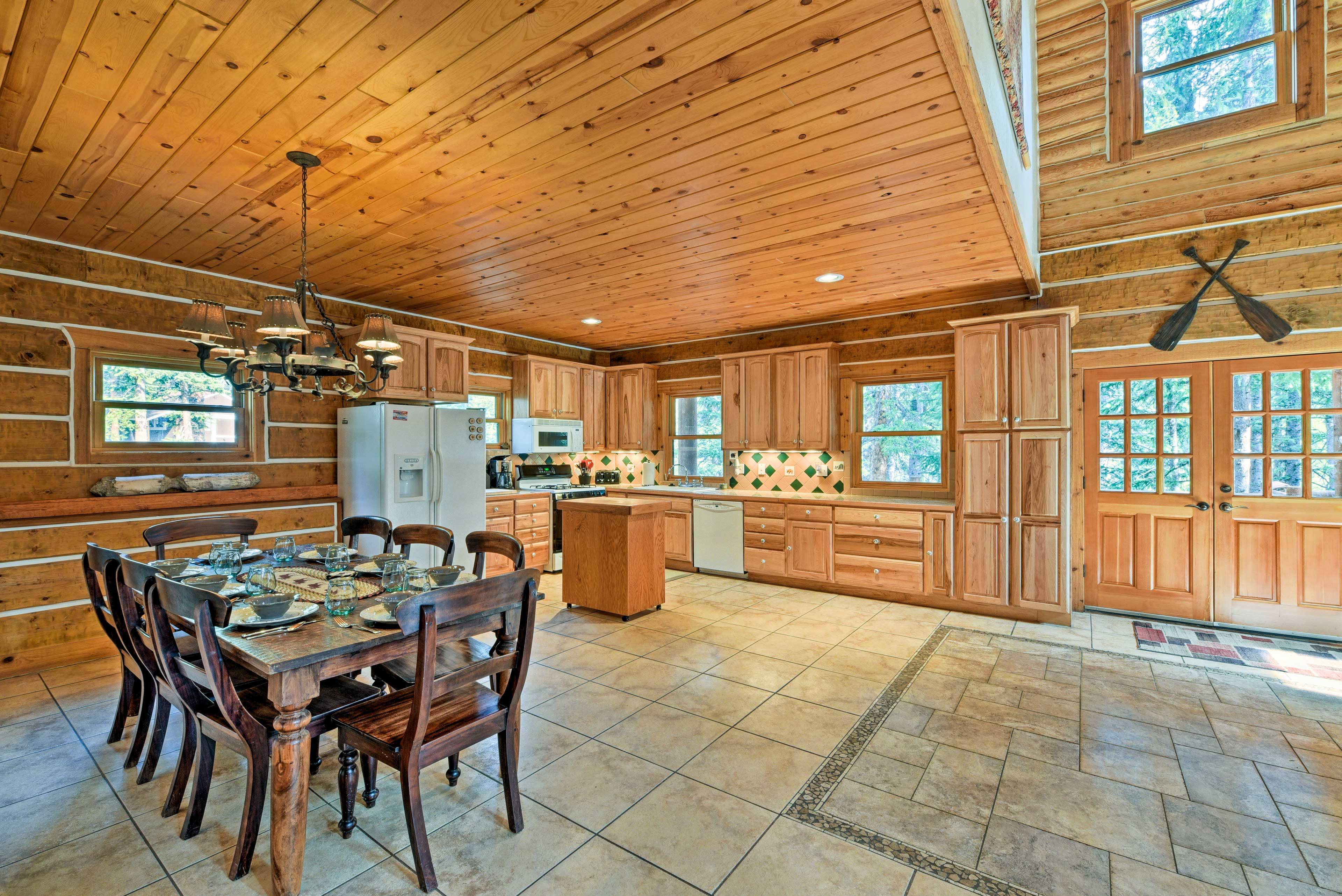 A fully equipped kitchen rests at the opposite end of the main level.