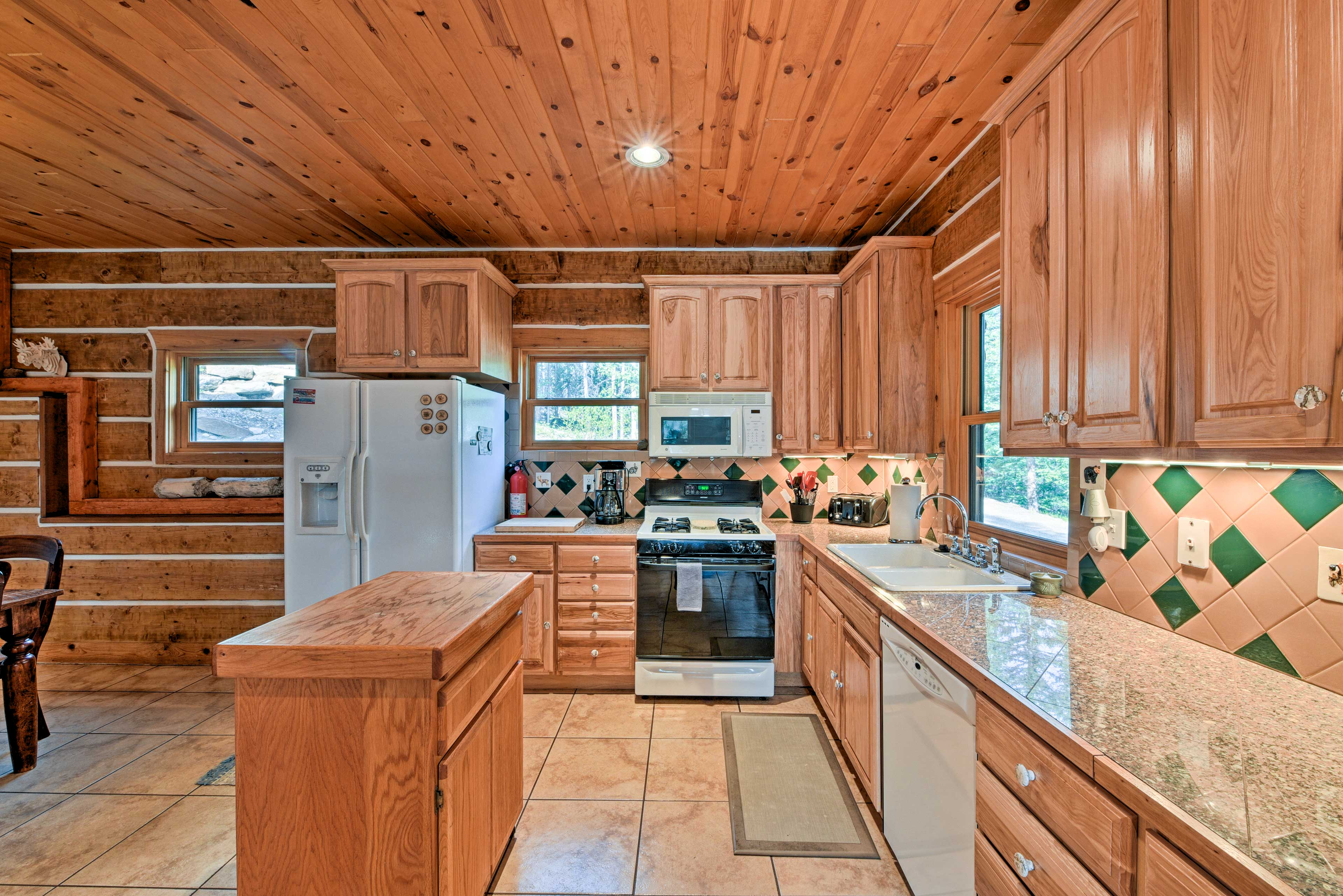 Extended counters and a chopping block on the island provide ample space.