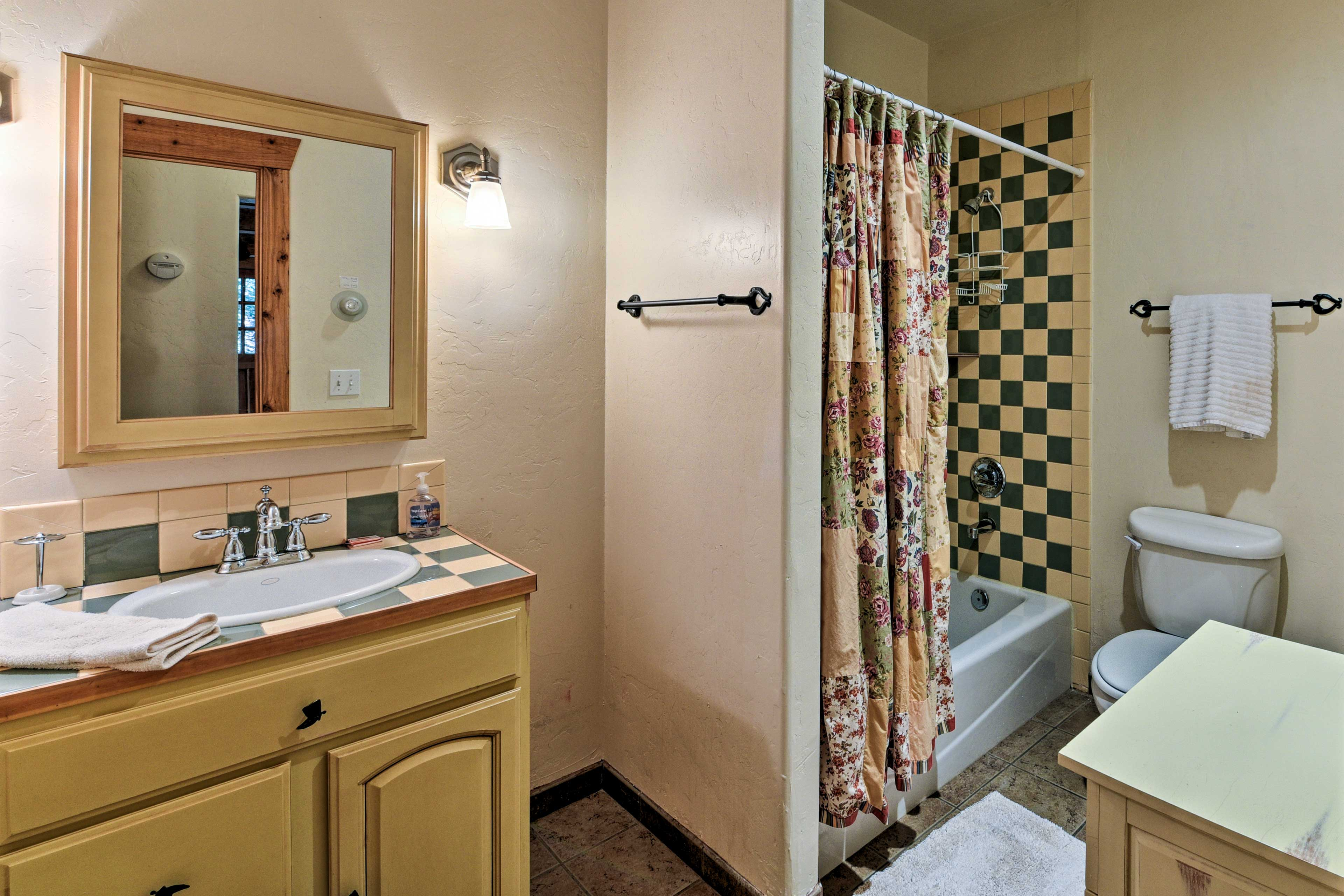 The main floor features a full bathroom with a shower/tub combo.