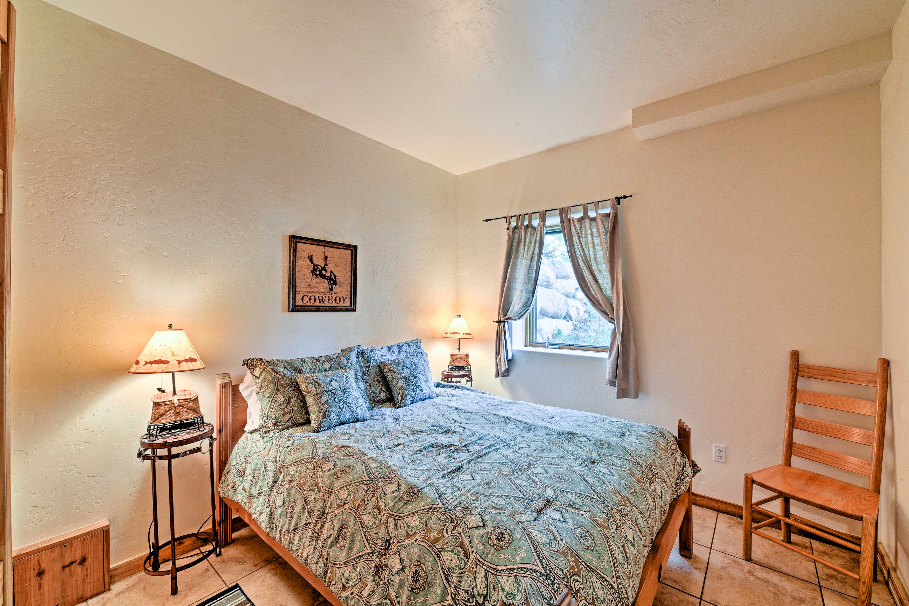 A second bedroom on the main floor features a queen bed.