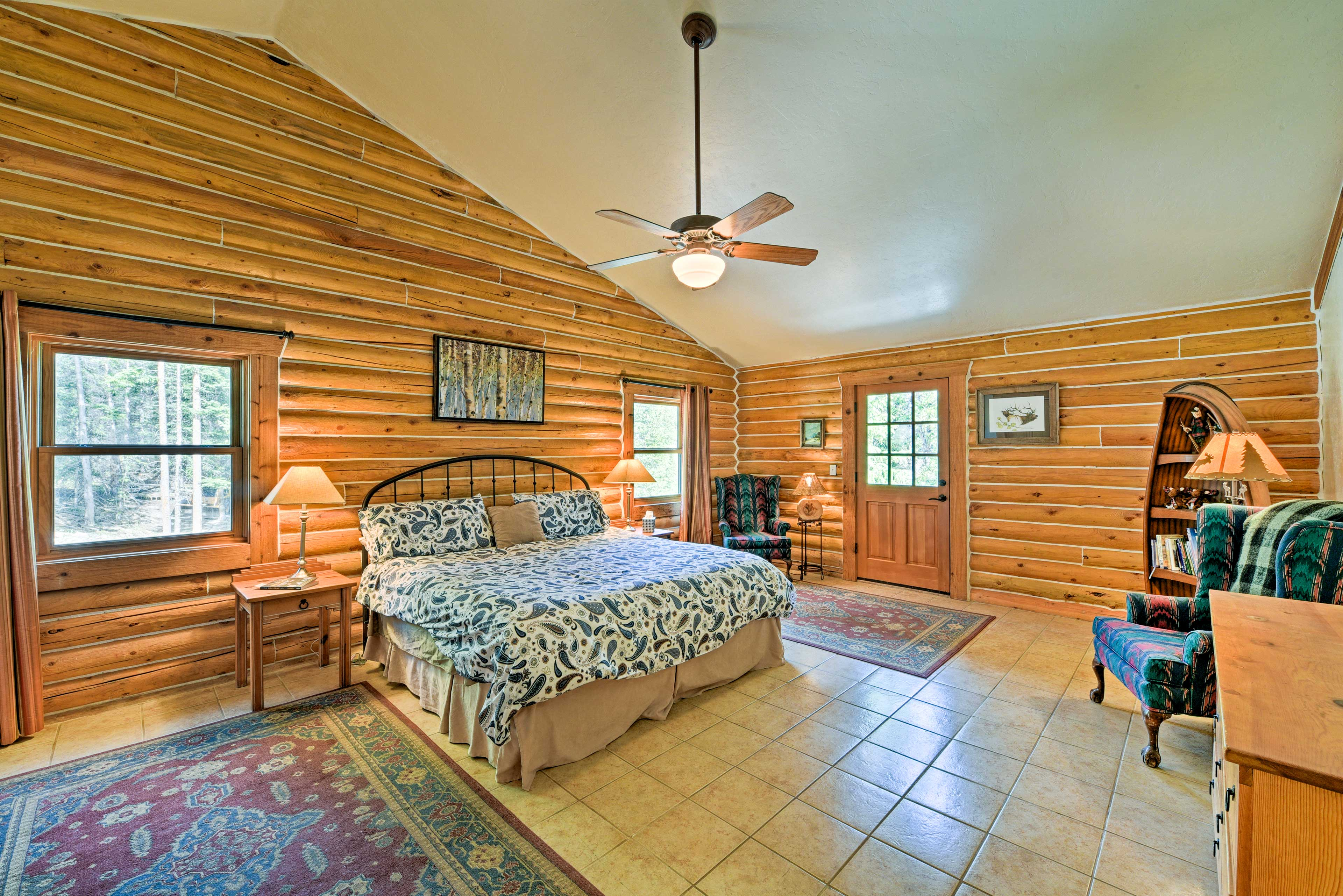The spacious master bedroom features a king-sized bed.