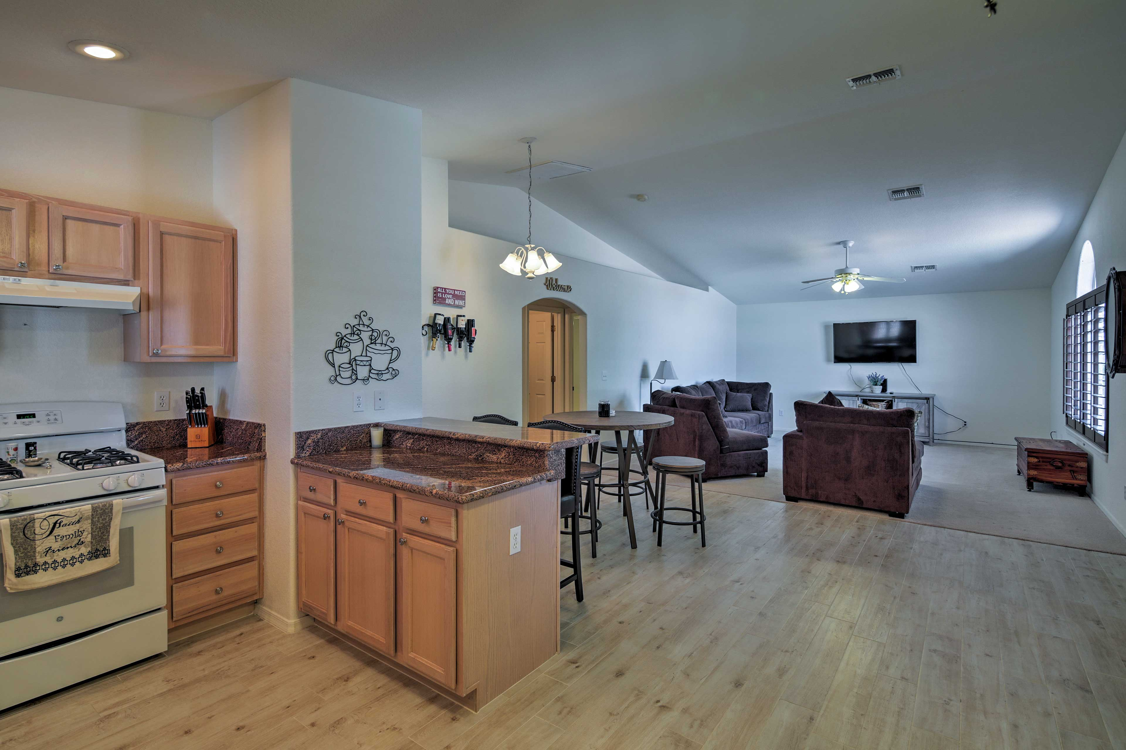 The fully equipped kitchen sits just steps from the living room.