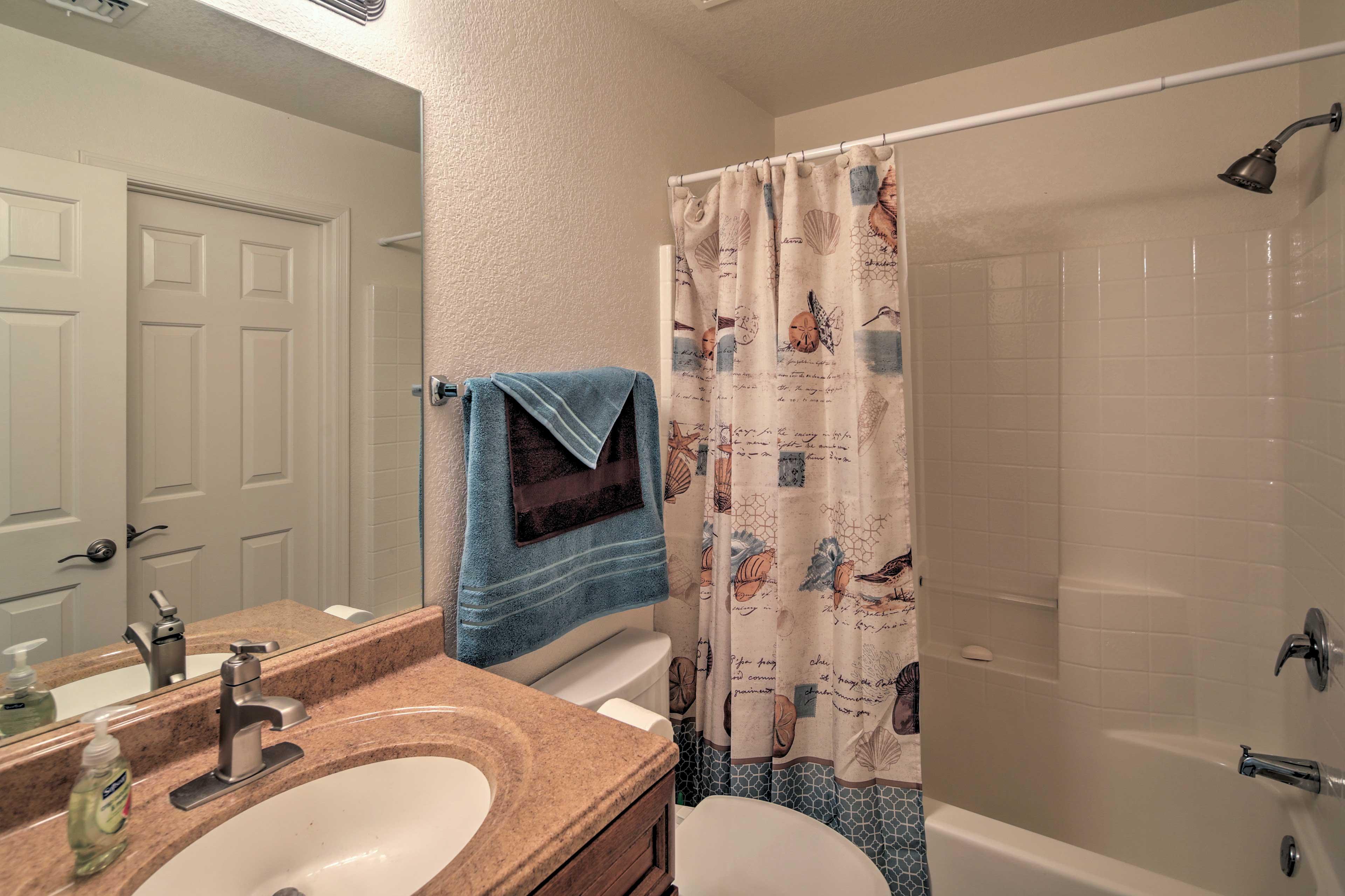 Boasting a granite vanity this bathroom is elegant and practical.