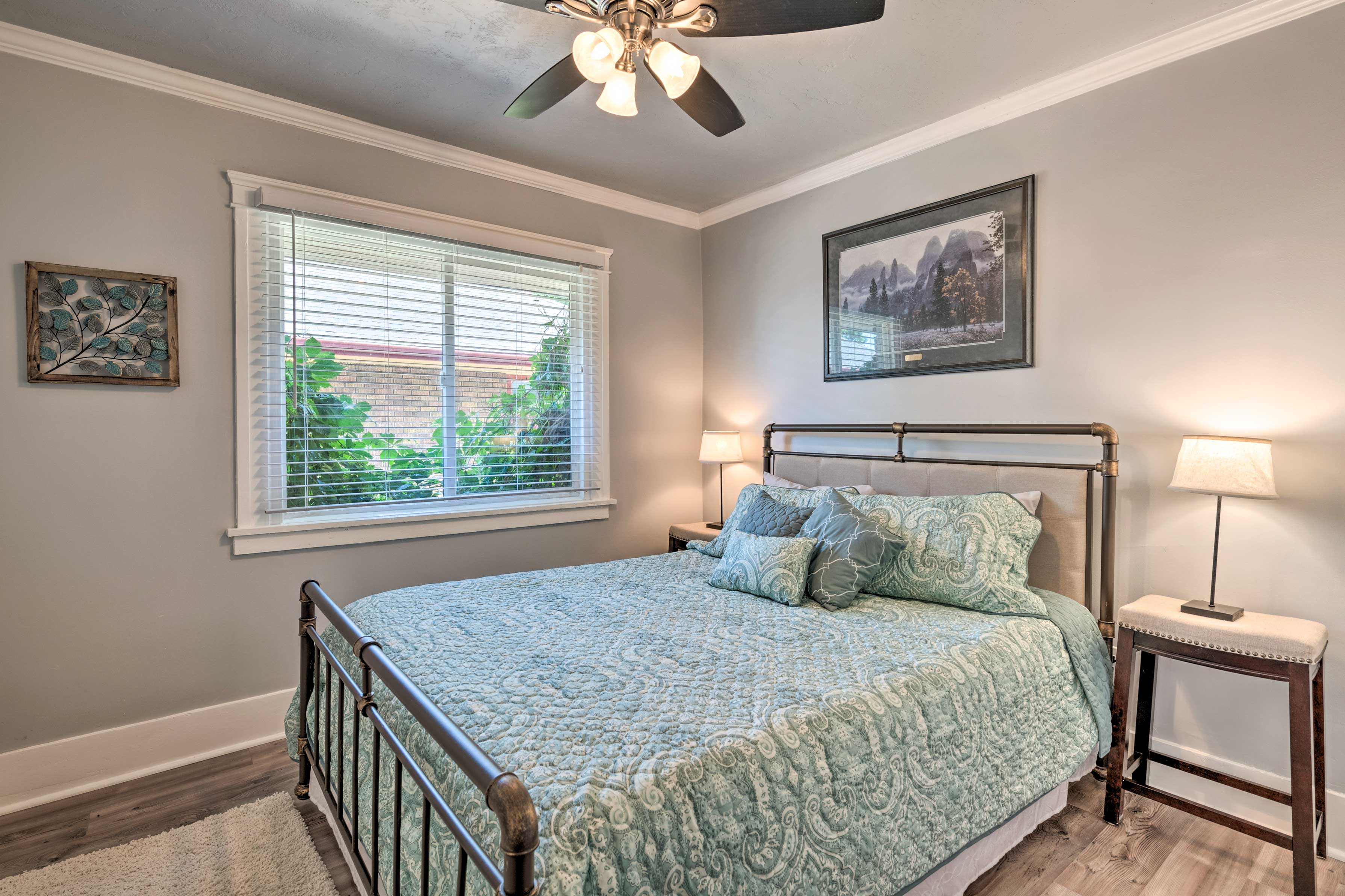 A queen bedroom highlights this spacious bedroom.