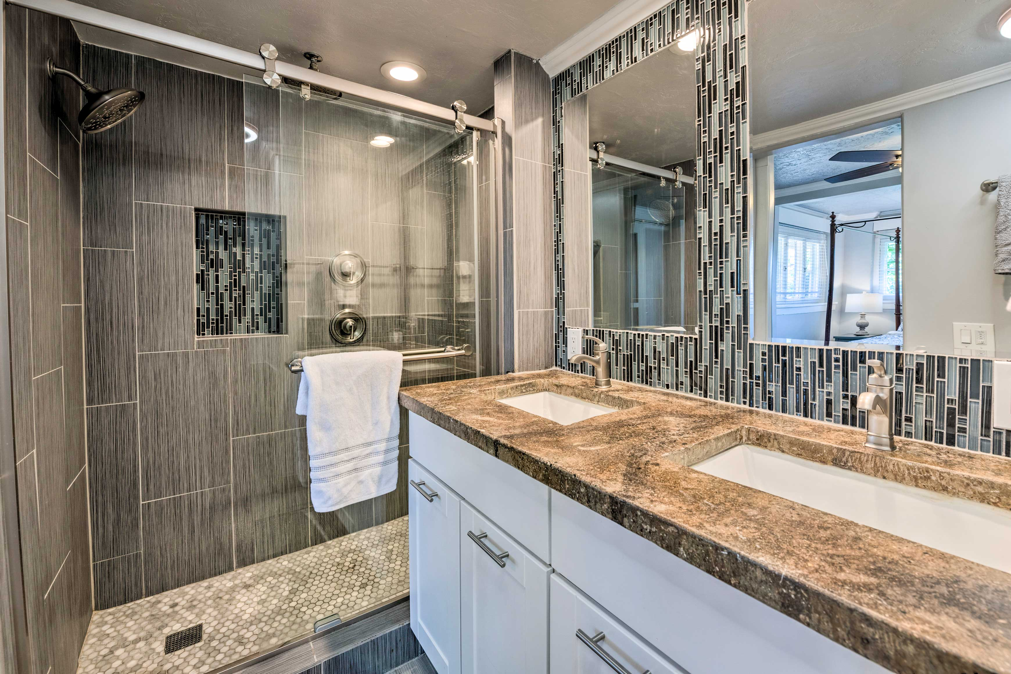 Rinse off in this immaculate bathroom.