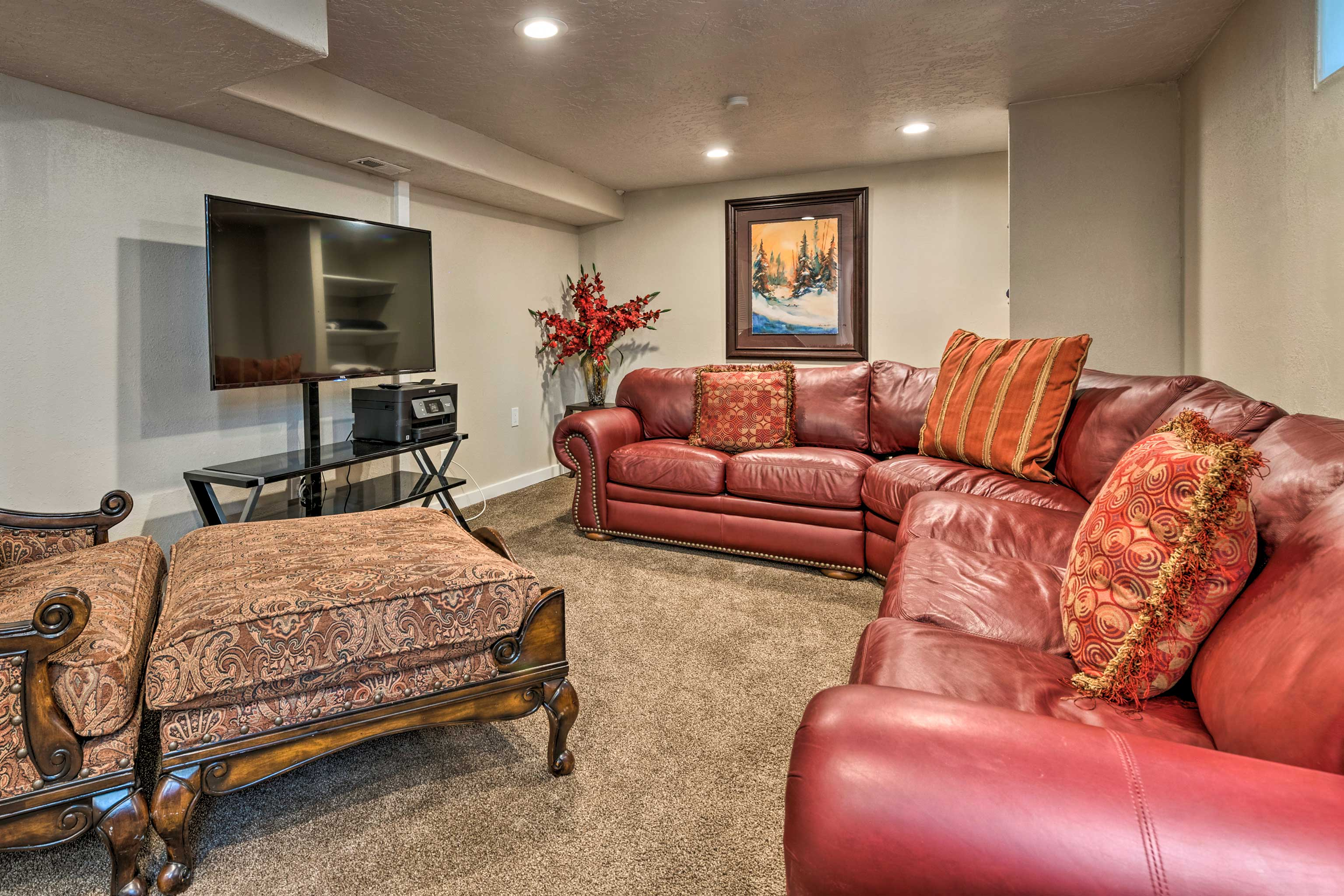 Watch a movie on the flat-screen TV in the basement!