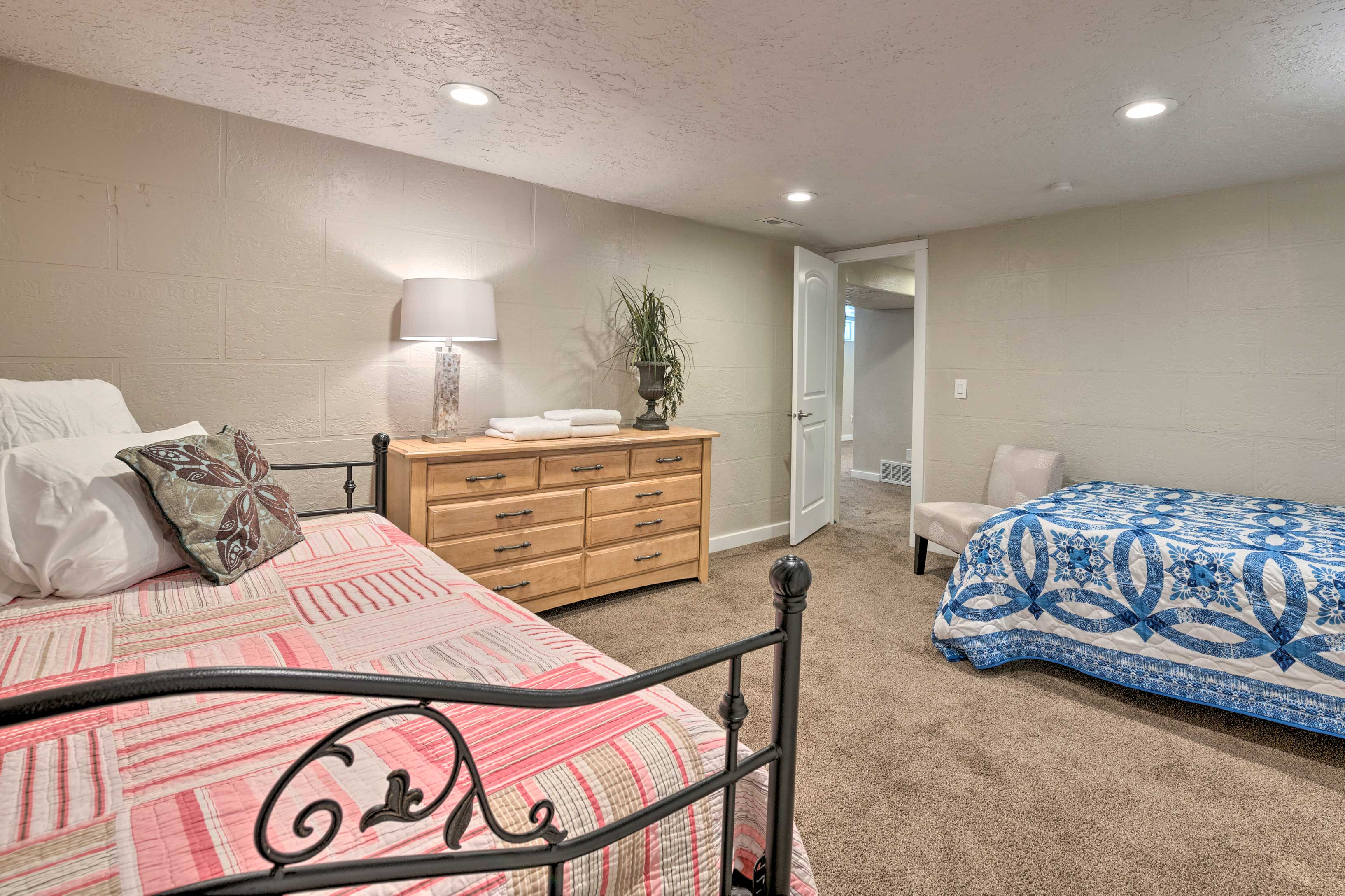 With a full bed, twin bed, and twin trundle bed, this room can sleep 4.