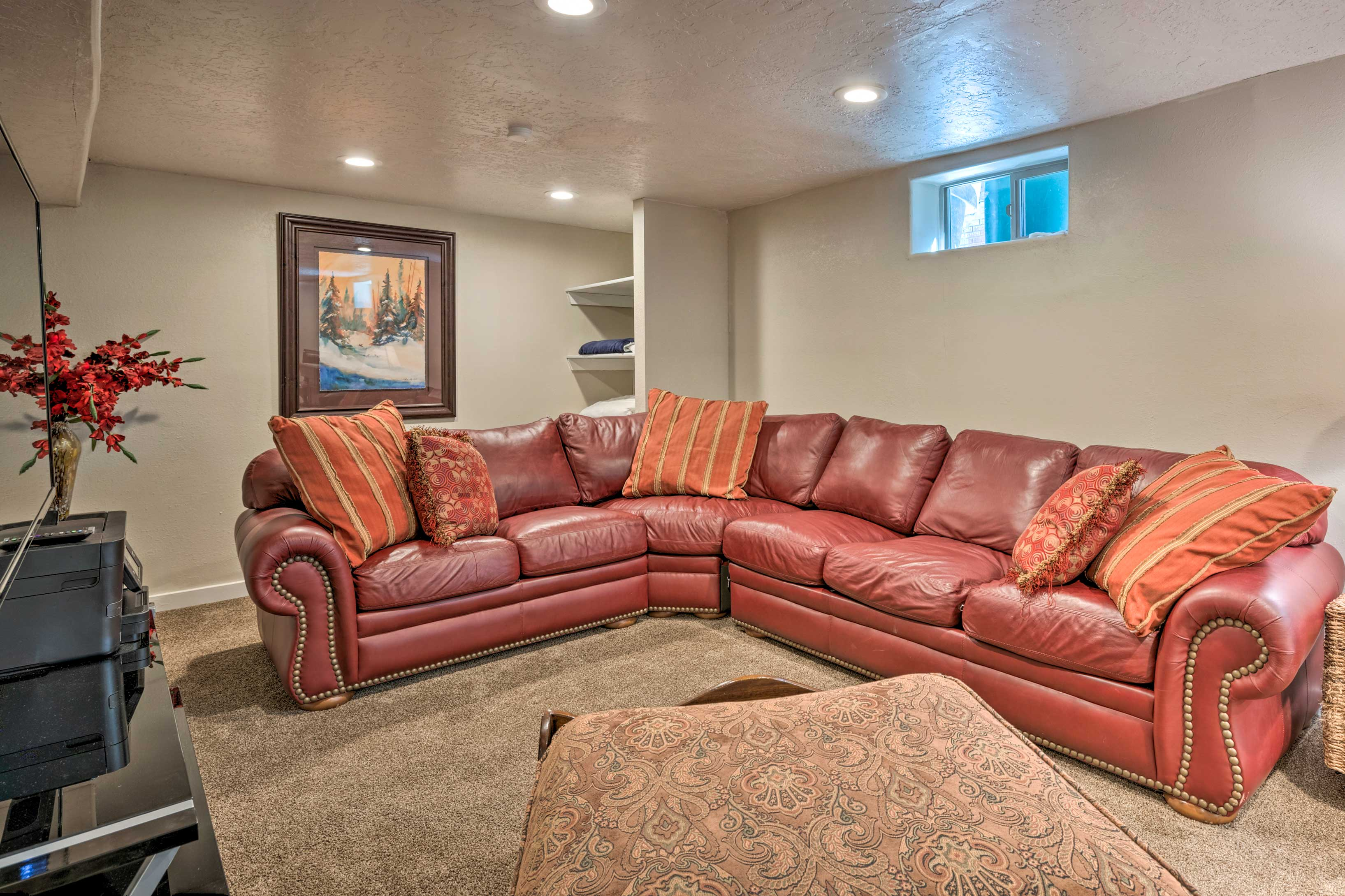 The red sectional is the perfect place to kick back.