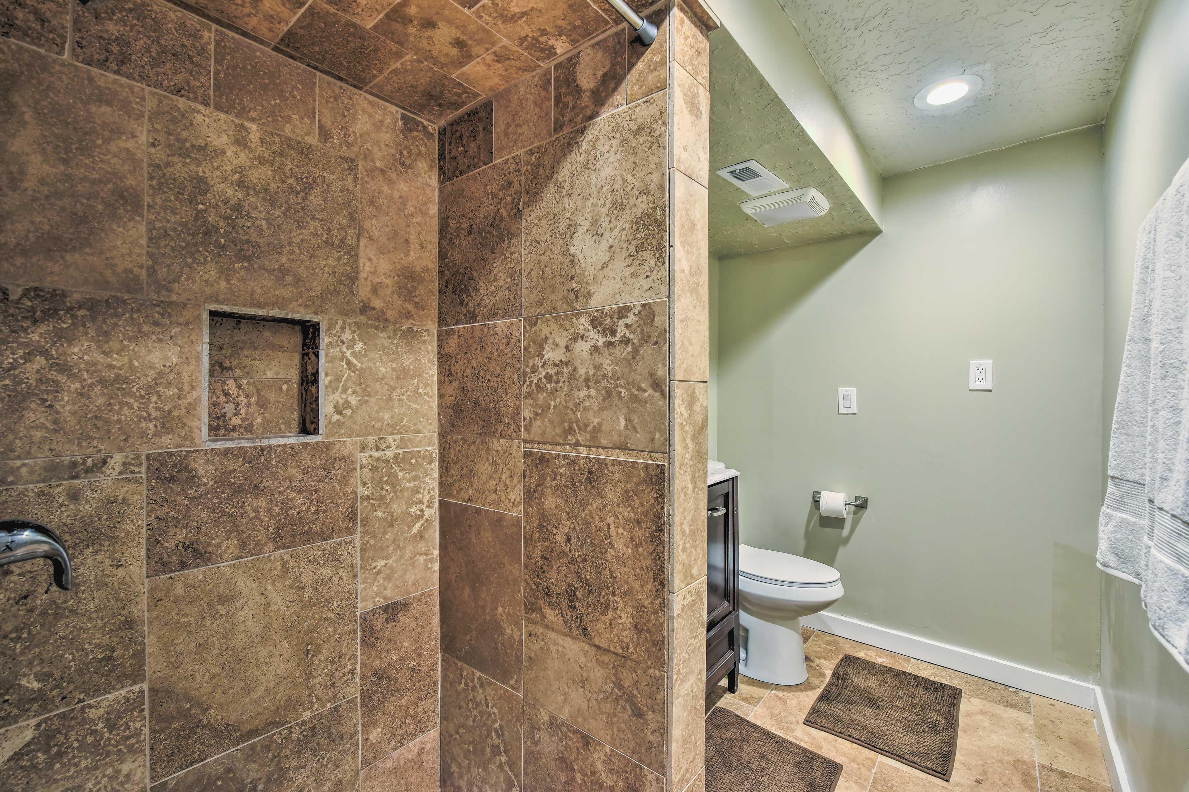 Enjoy washing off in this immaculate shower.