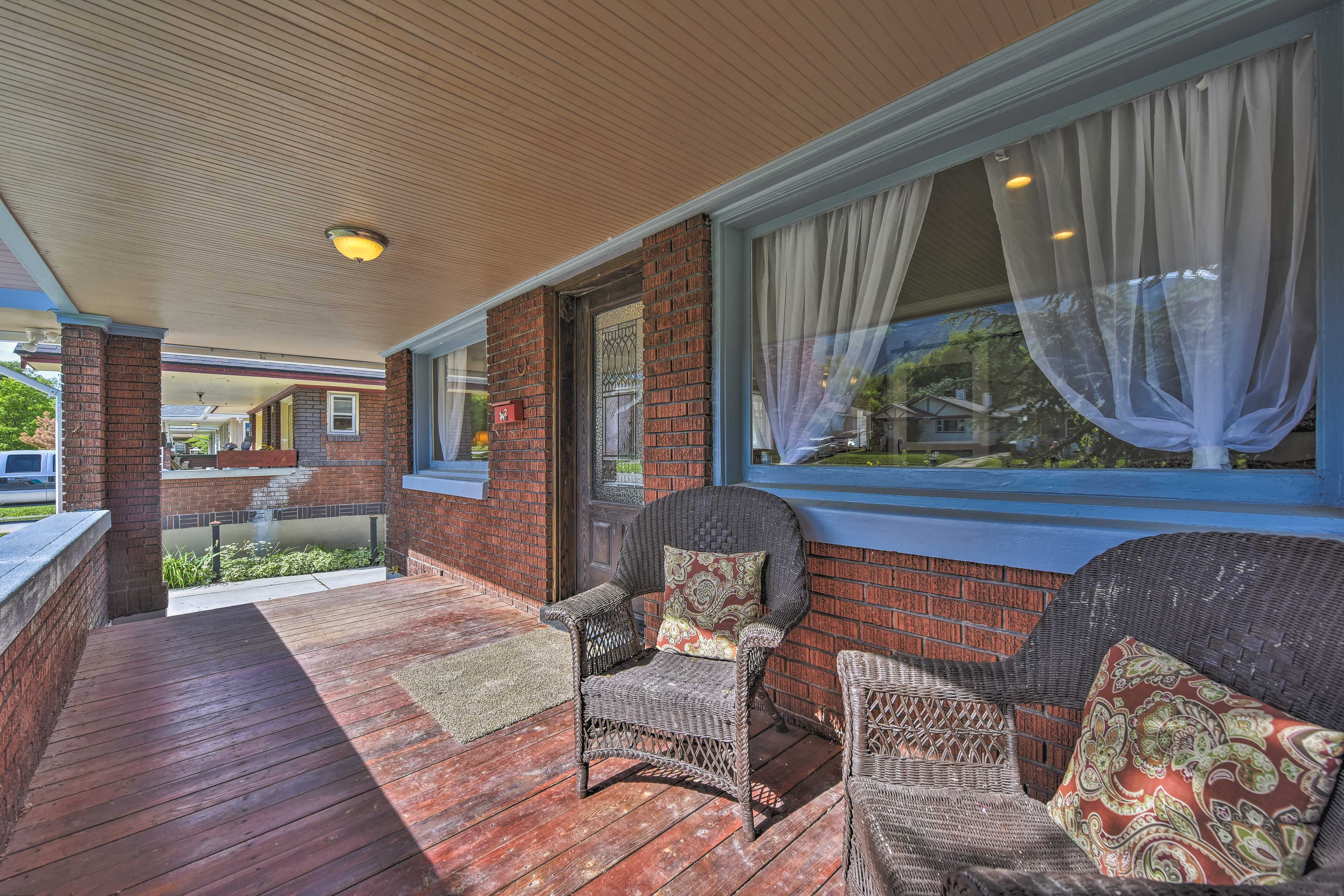 Enjoy time on the front porch of this Ogden vacation rental.