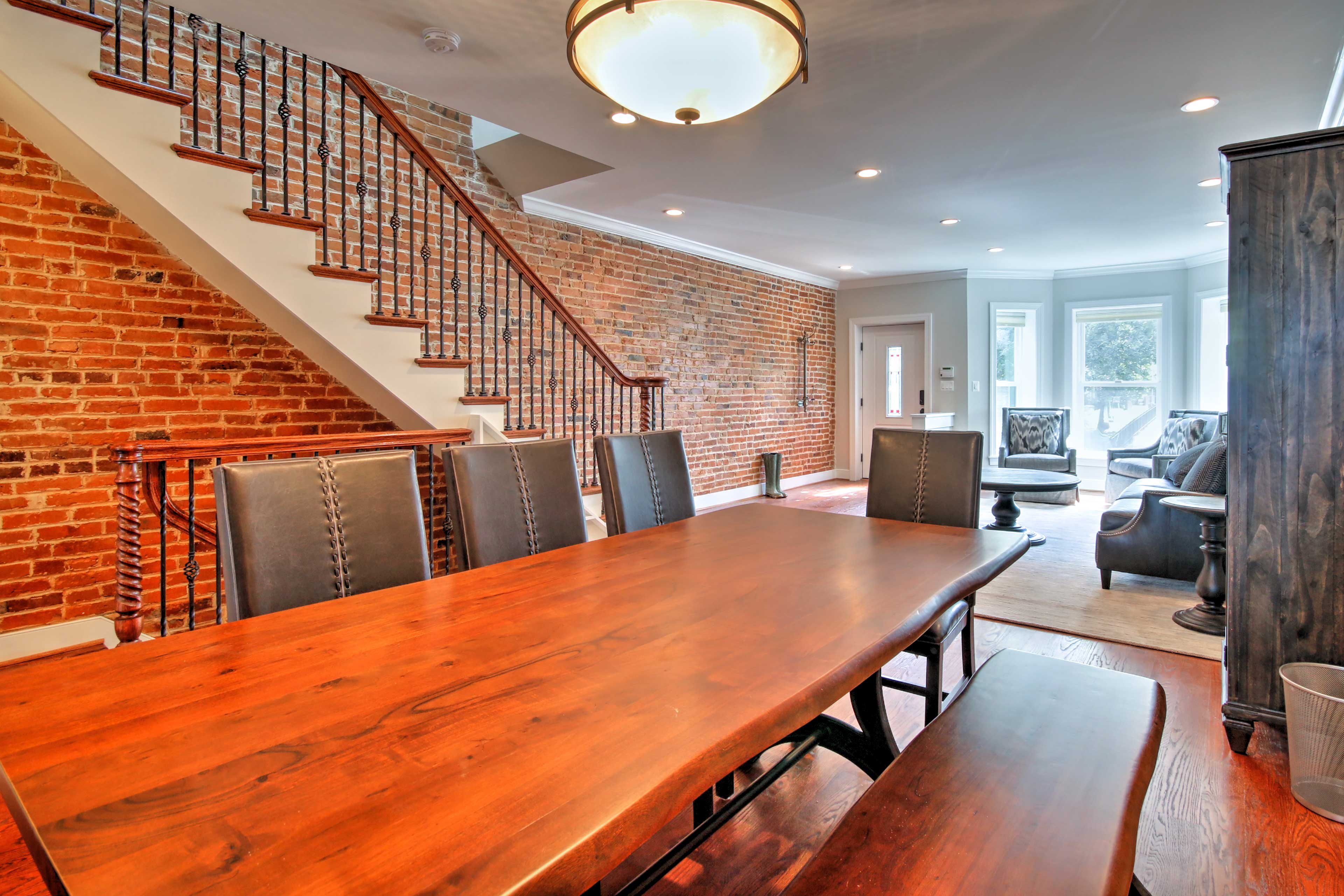 Enjoy formal meals at the large wooden dining table.