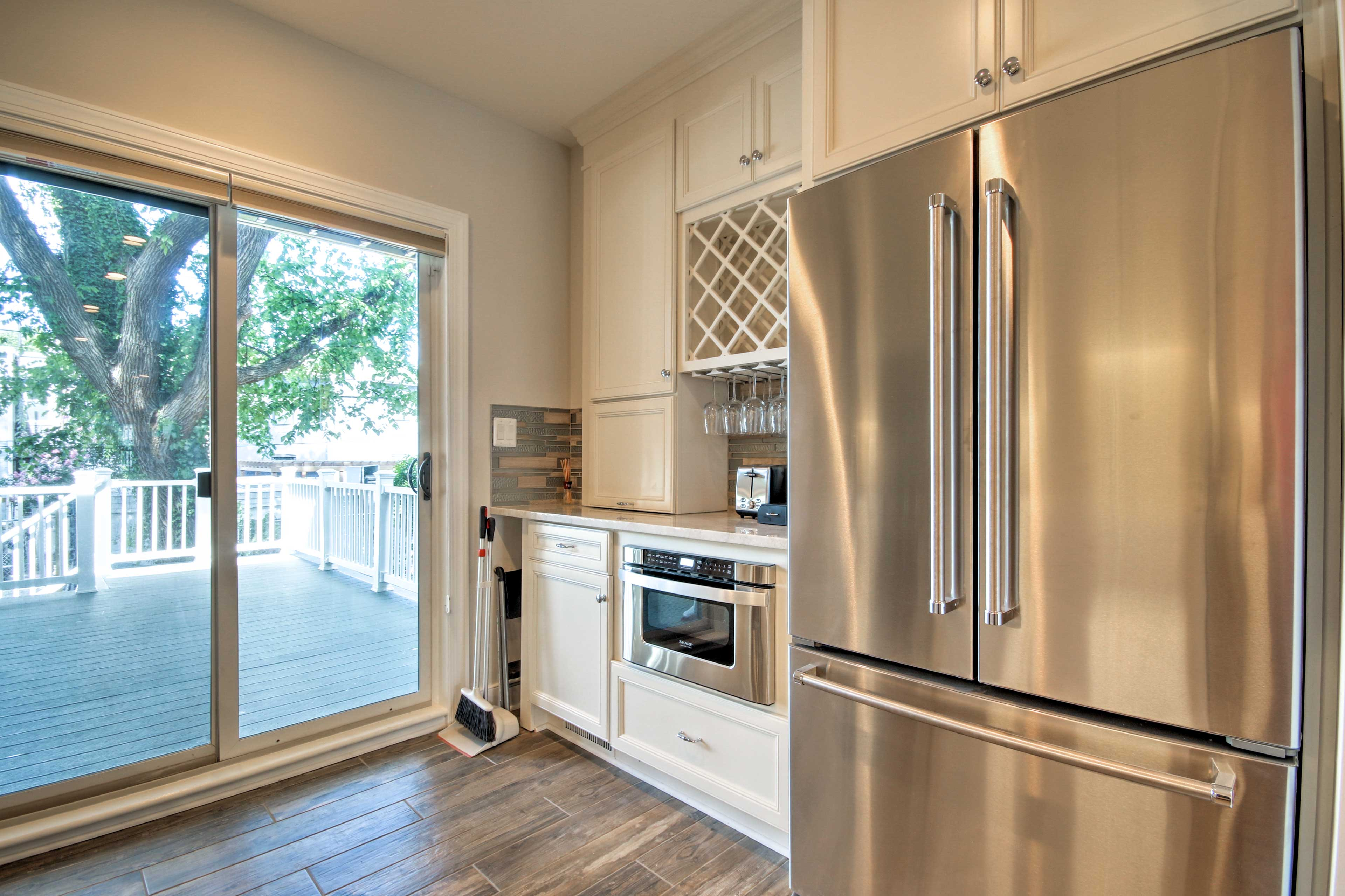 The kitchen features stainless steel appliances and marble countertops!