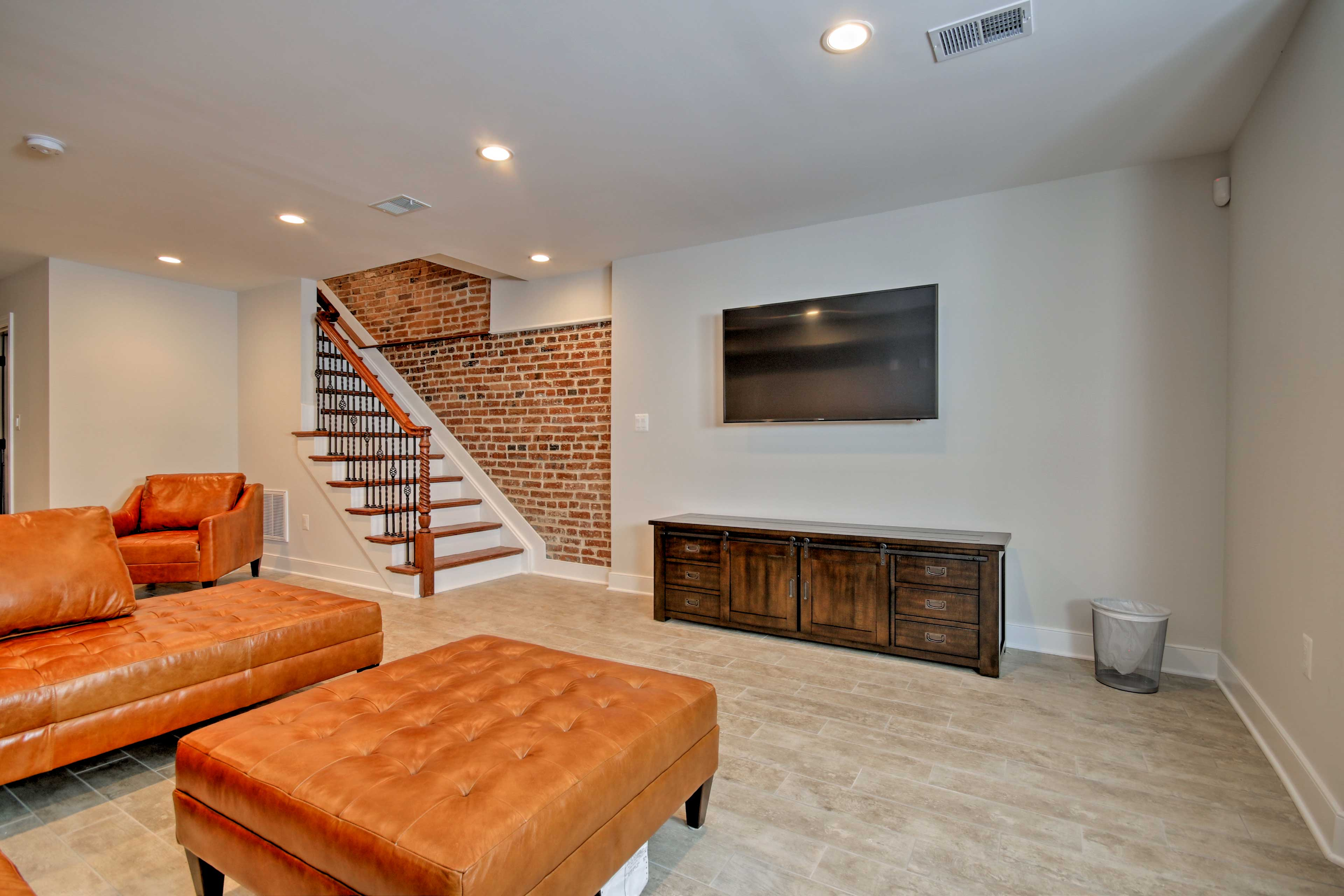 Watch your favorite shows on the 6-inch flat-screen cable TV in the den.
