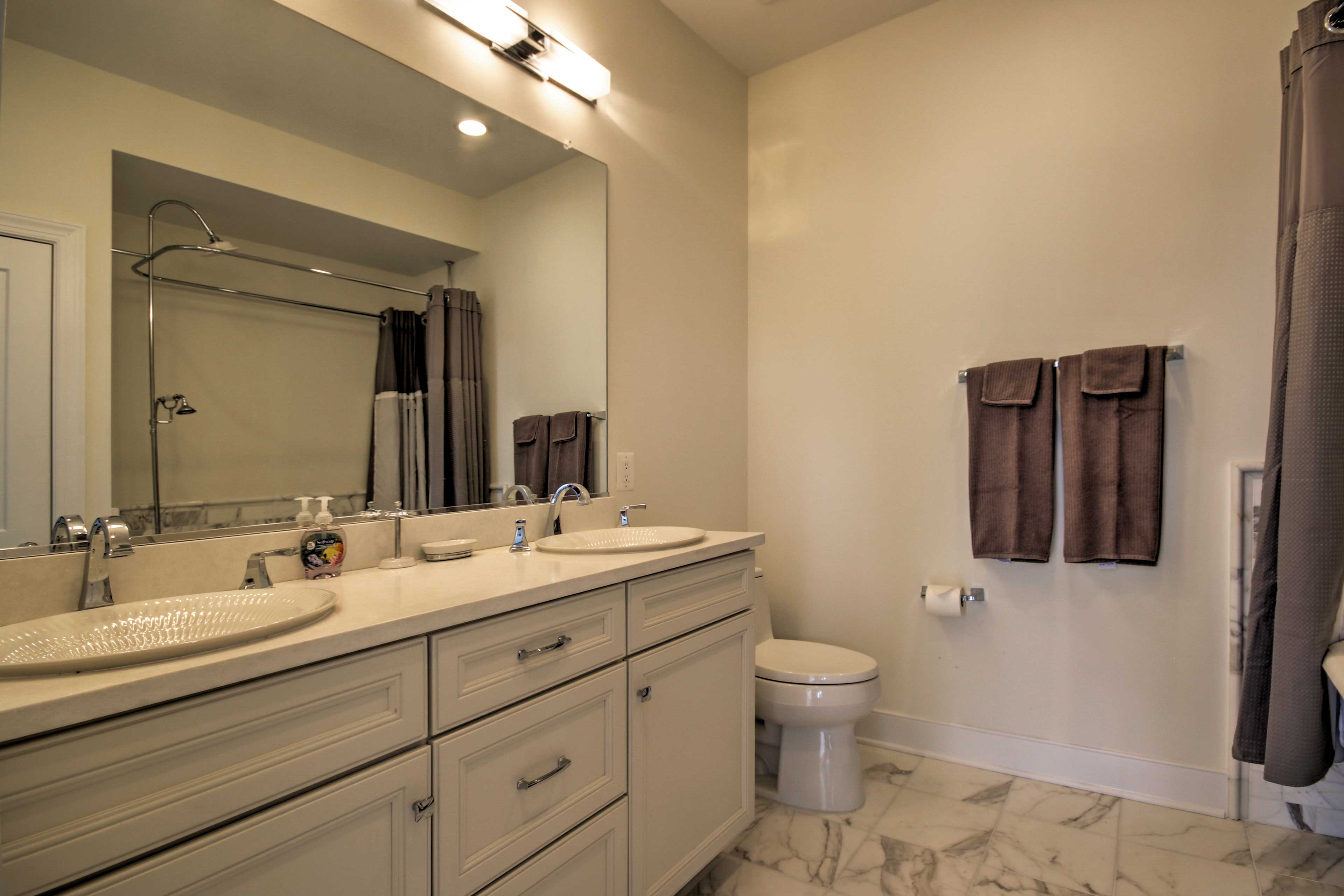 His and her sinks provide plenty of space in the master en-suite bathroom.