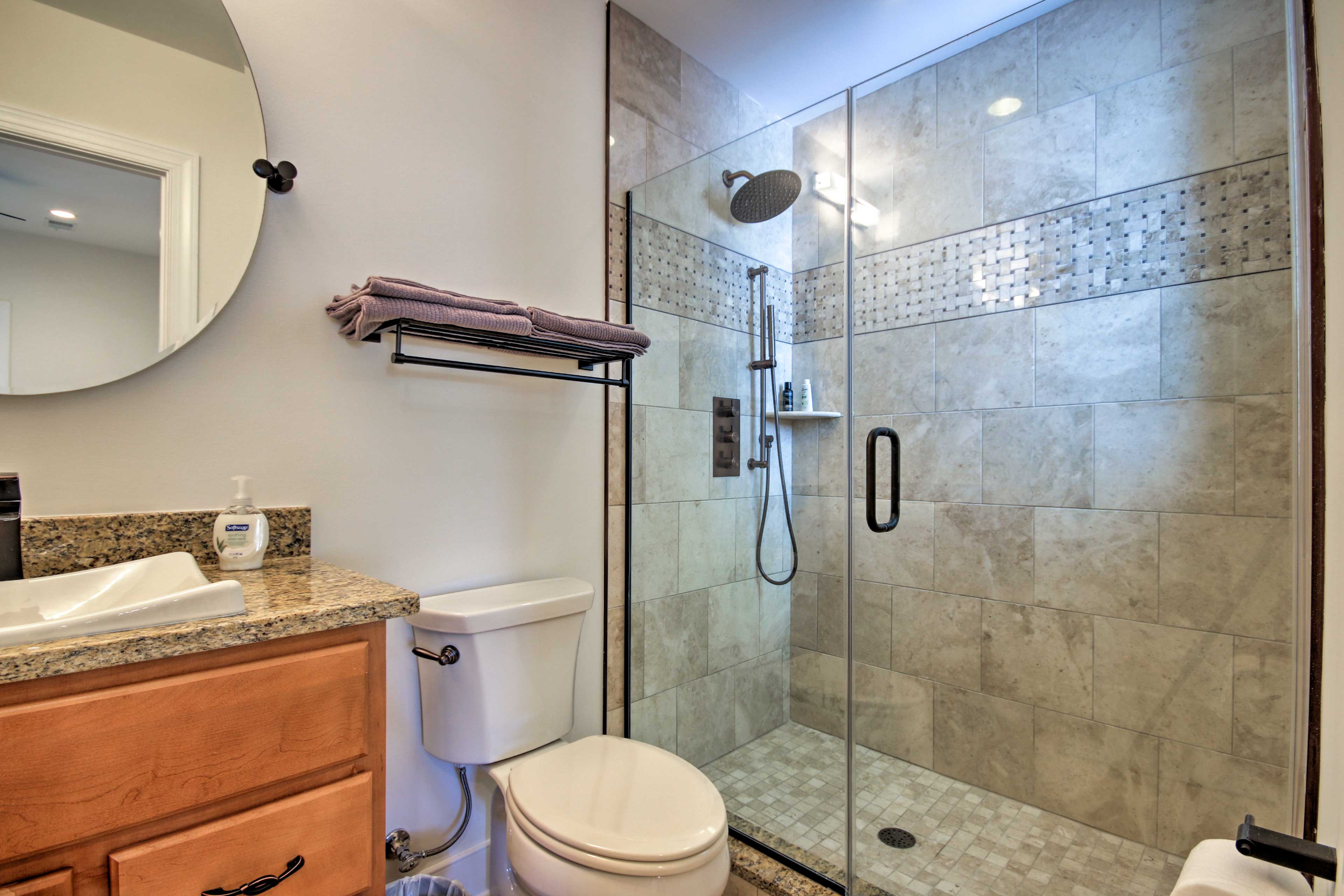 Rinse off the day in the beautiful tile-lined stand-up shower.