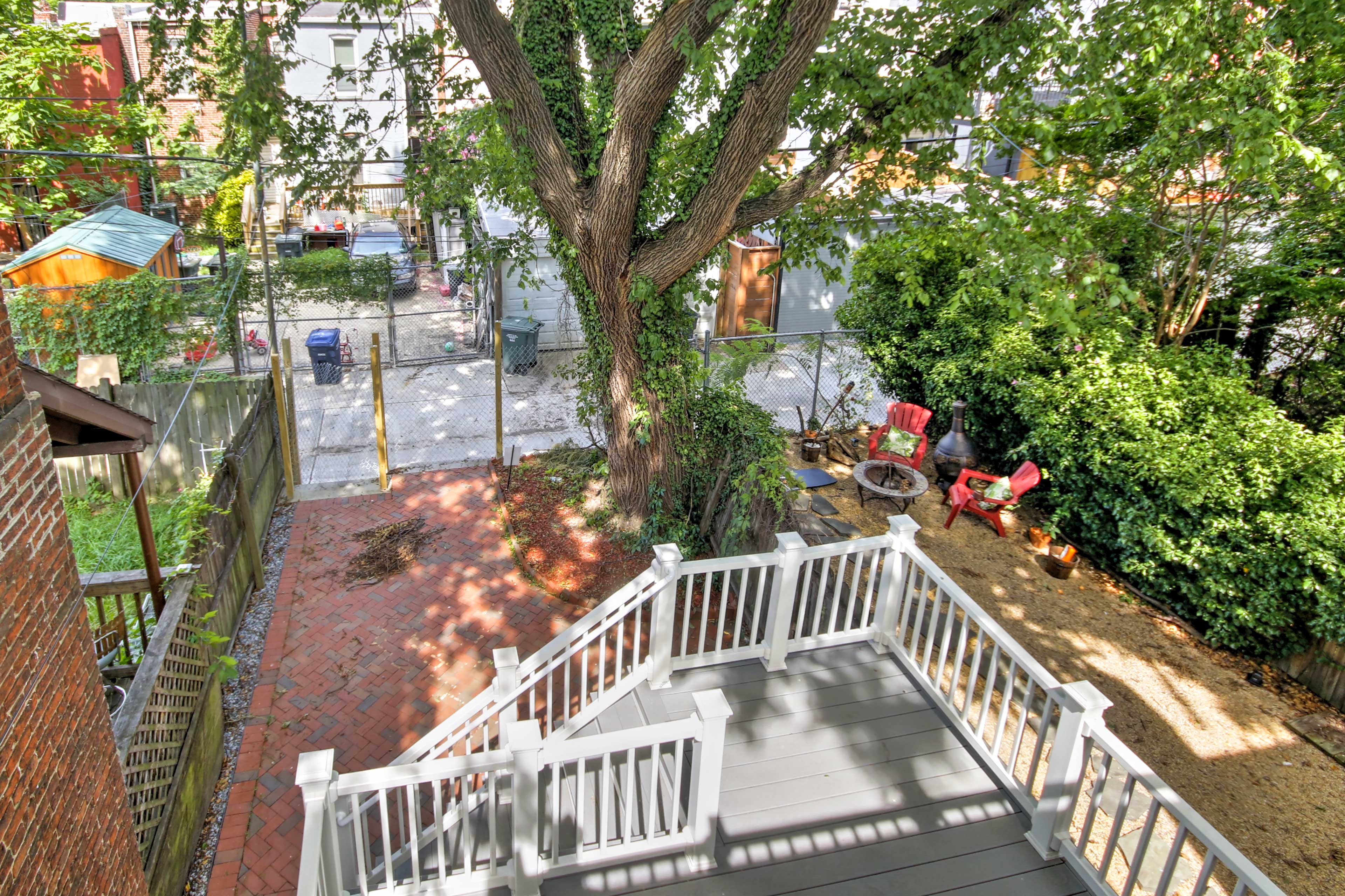 The backyard is outfitted with pavers and plenty of privacy.
