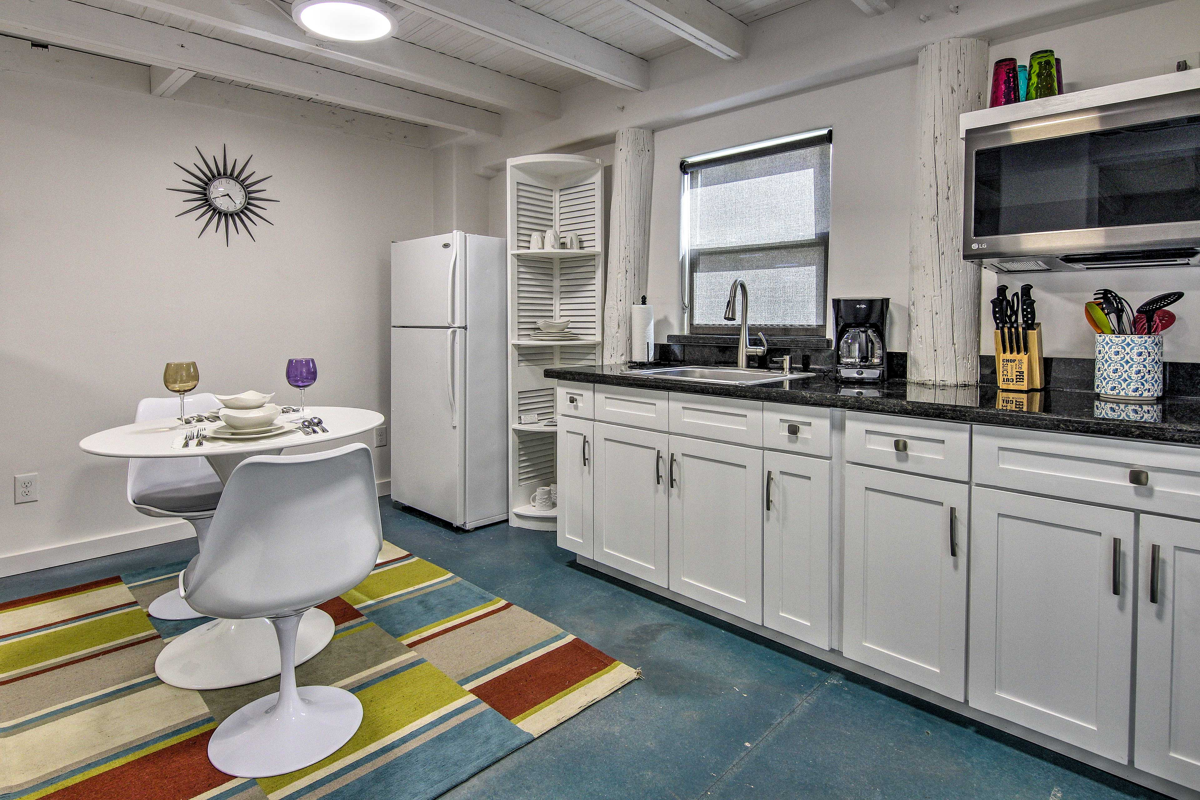 The kitchen includes a toaster over, induction cooktop, microwave, and more.