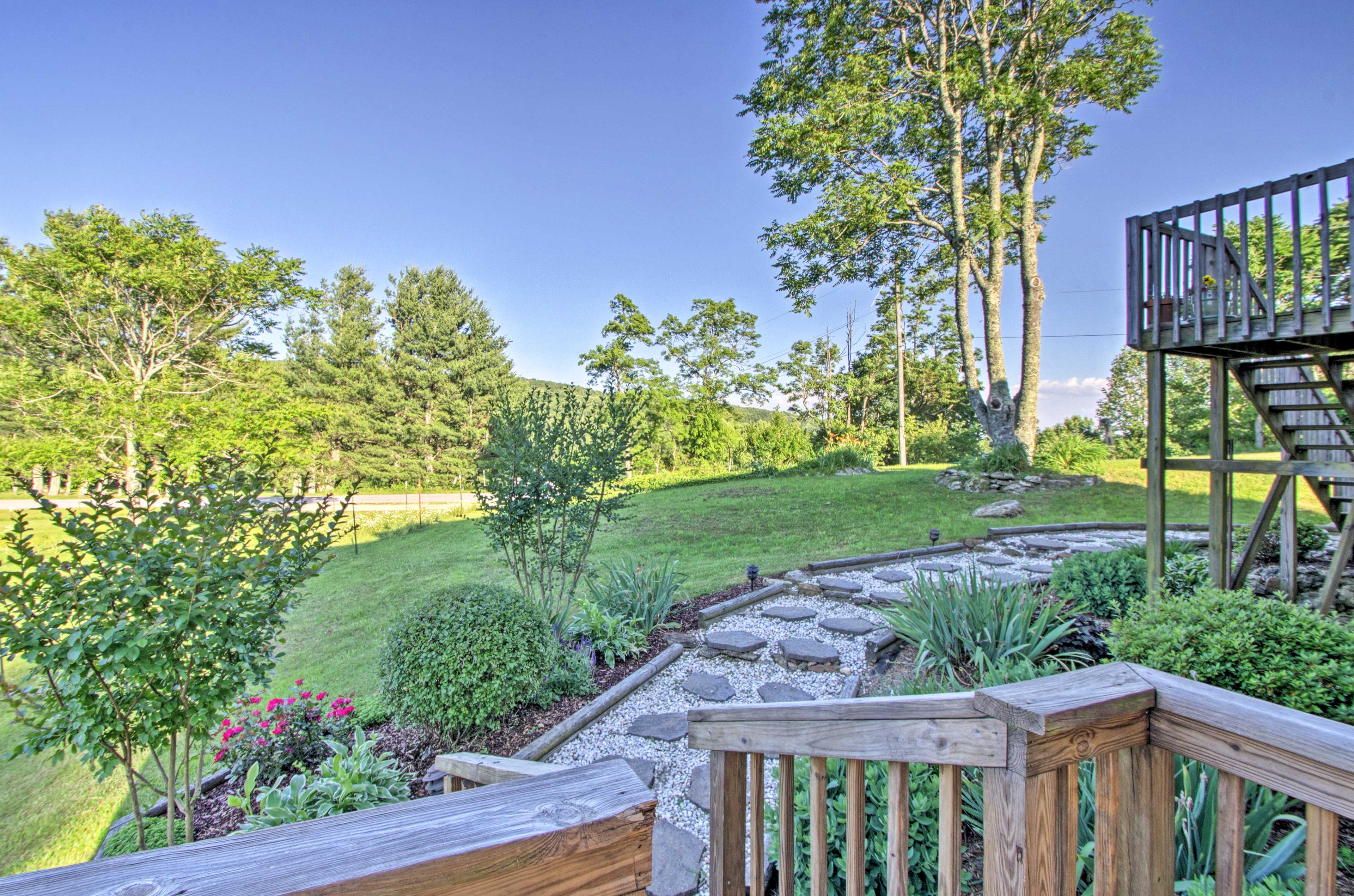 Verdant landscaping surrounds this property.