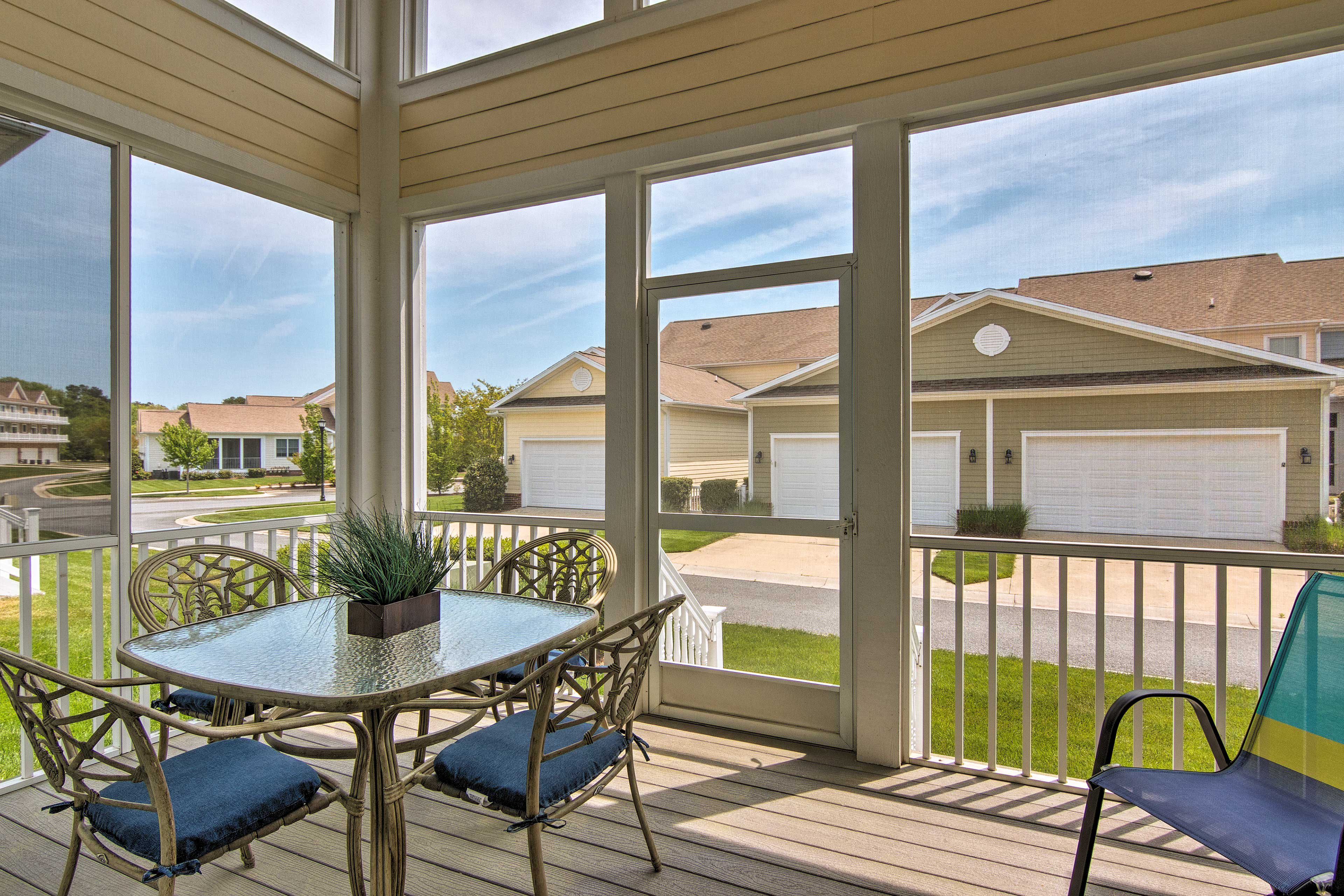 The screened-in porch is ideal for sipping coffee in your serene setting.