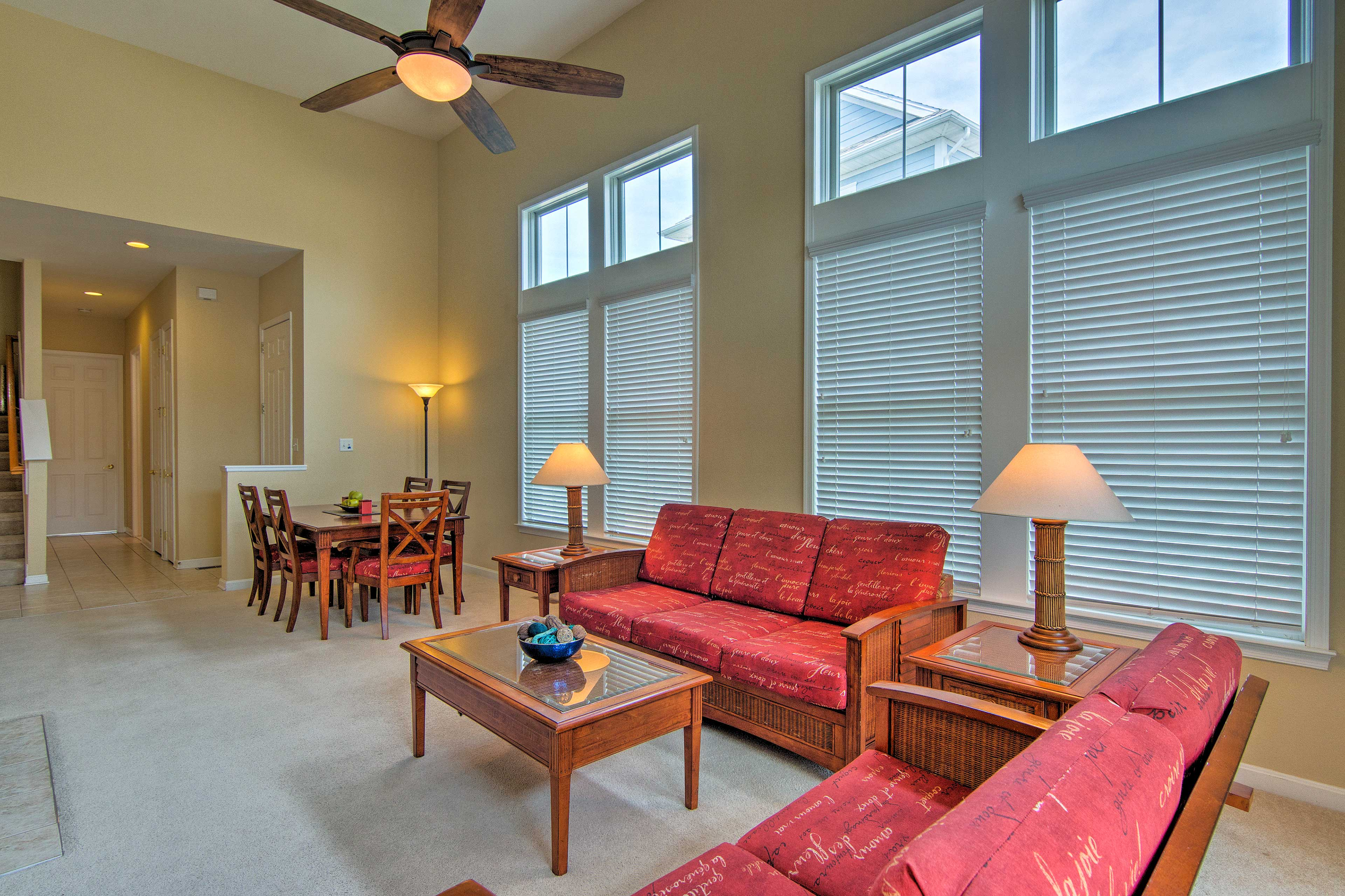 Picture windows and sliding glass doors let natural light illuminate the space.